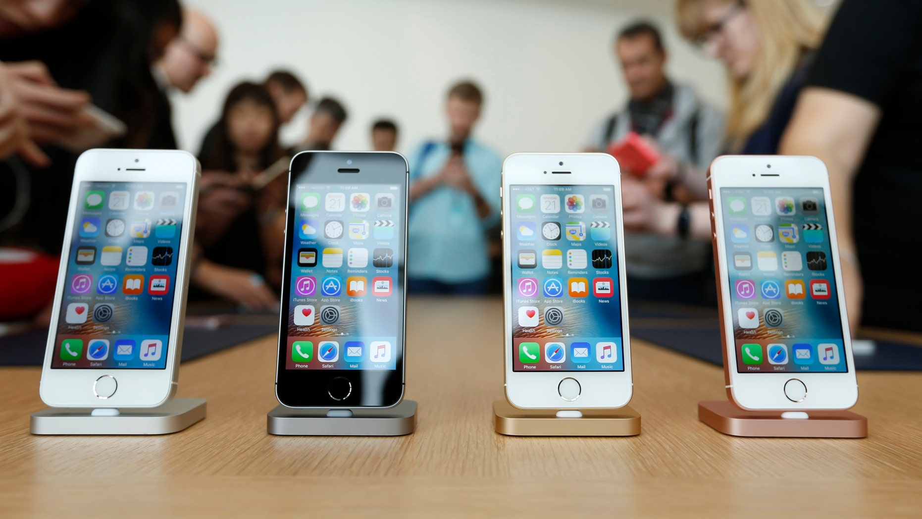 The new iPhone SE is seen on display during an event at the Apple headquarters in Cupertino, Calif. March 21, 2016. (REUTERS/Stephen Lam)