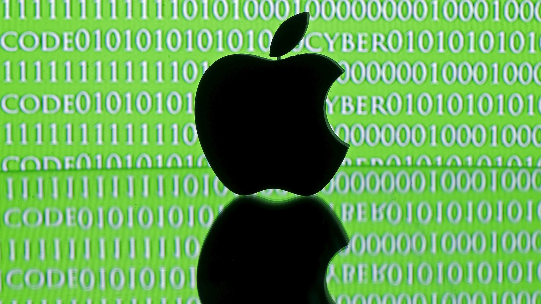 A 3D-printed Apple logo is seen in front of a displayed cyber code in this illustration taken Feb. 26, 2016.