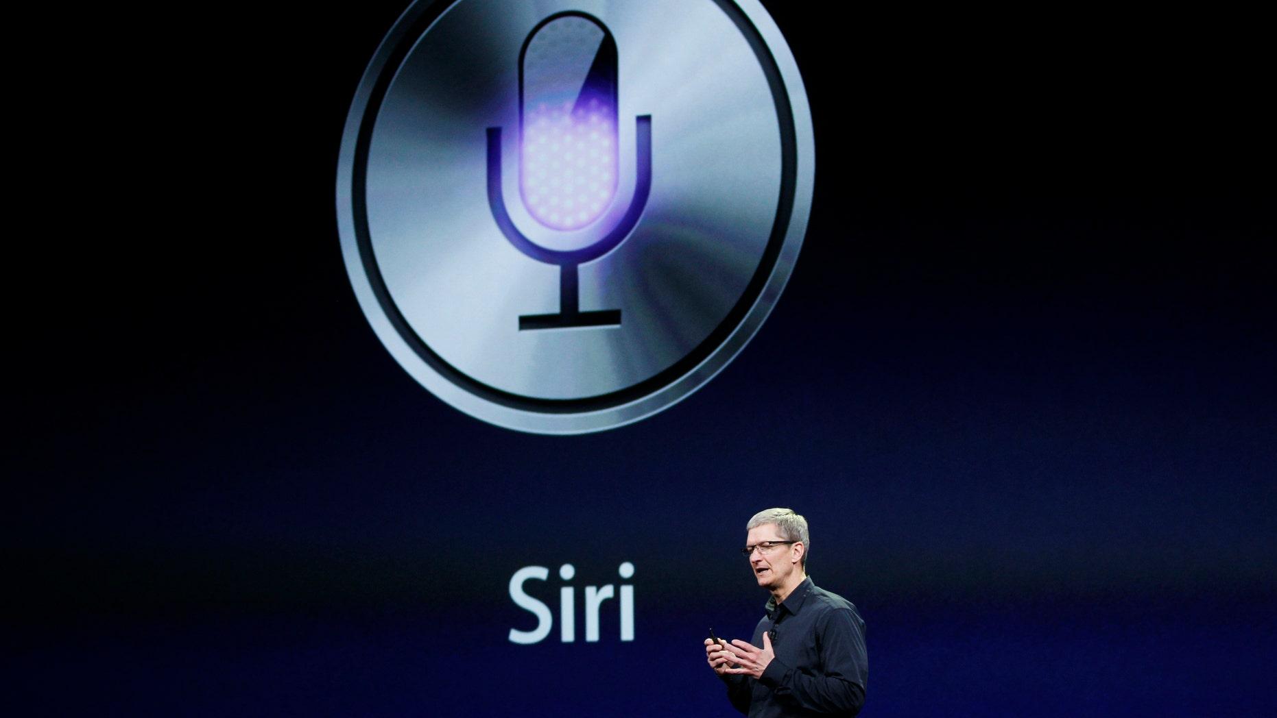 Apple CEO Tim Cook talks about Siri during an Apple event March 7, 2012. (REUTERS/Robert Galbraith)