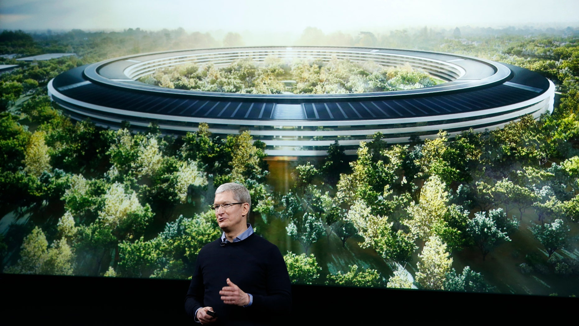 File photo - Apple CEO Tim Cook speaks during an event at the Apple headquarters in Cupertino, California March 21, 2016. (REUTERS/Stephen Lam)