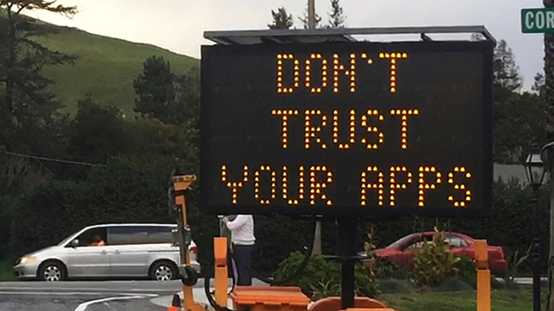 """This undated photo provided by the City of Fremont, Calif., shows a blinking sign warning drivers: """"Don't Trust Your Apps,"""" in Fremont, Calif. The sign was part of the city's response to combatting the congestion caused by traffic being diverted onto neighborhood and side streets by digital maps that direct motorists away from highway traffic jams. (City of Fremont, Calif. via AP)"""