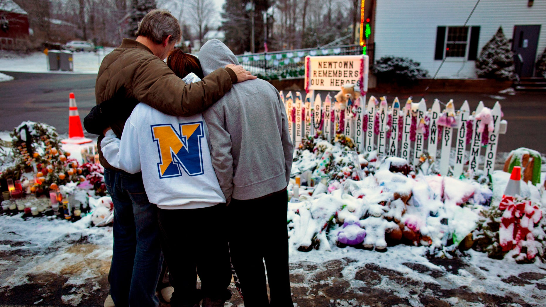 Members of the Newton community mourn those lost in the Sandy Hook Elementary School massacre.