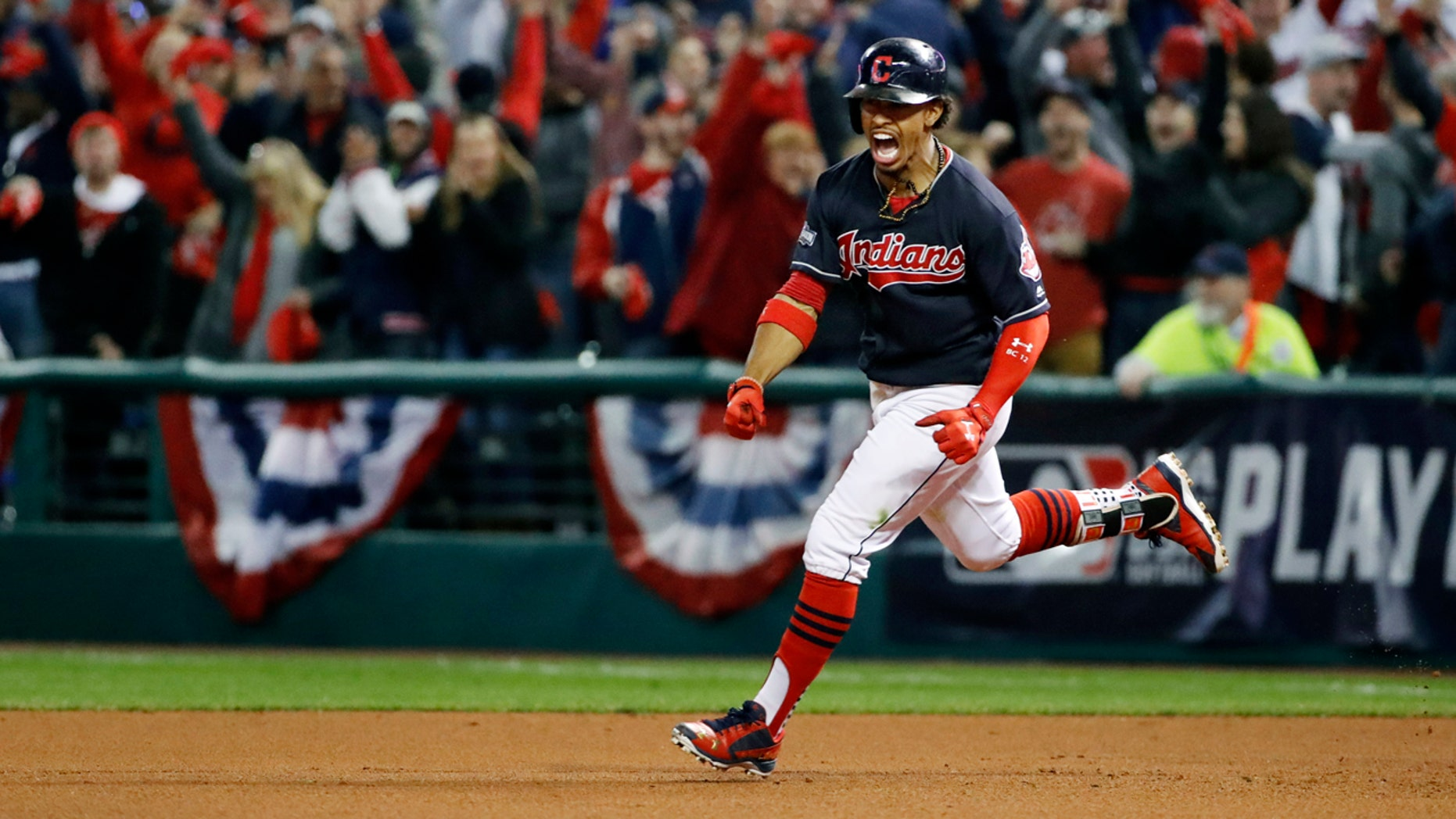 Cleveland Indians' Francisco Lindor rounds the bases on his two-run home run against the Toronto Blue Jays during the sixth inning in Game 1 of baseball's American League Championship Series in Cleveland, Friday, Oct. 14, 2016.(AP Photo/Gene J. Puskar)