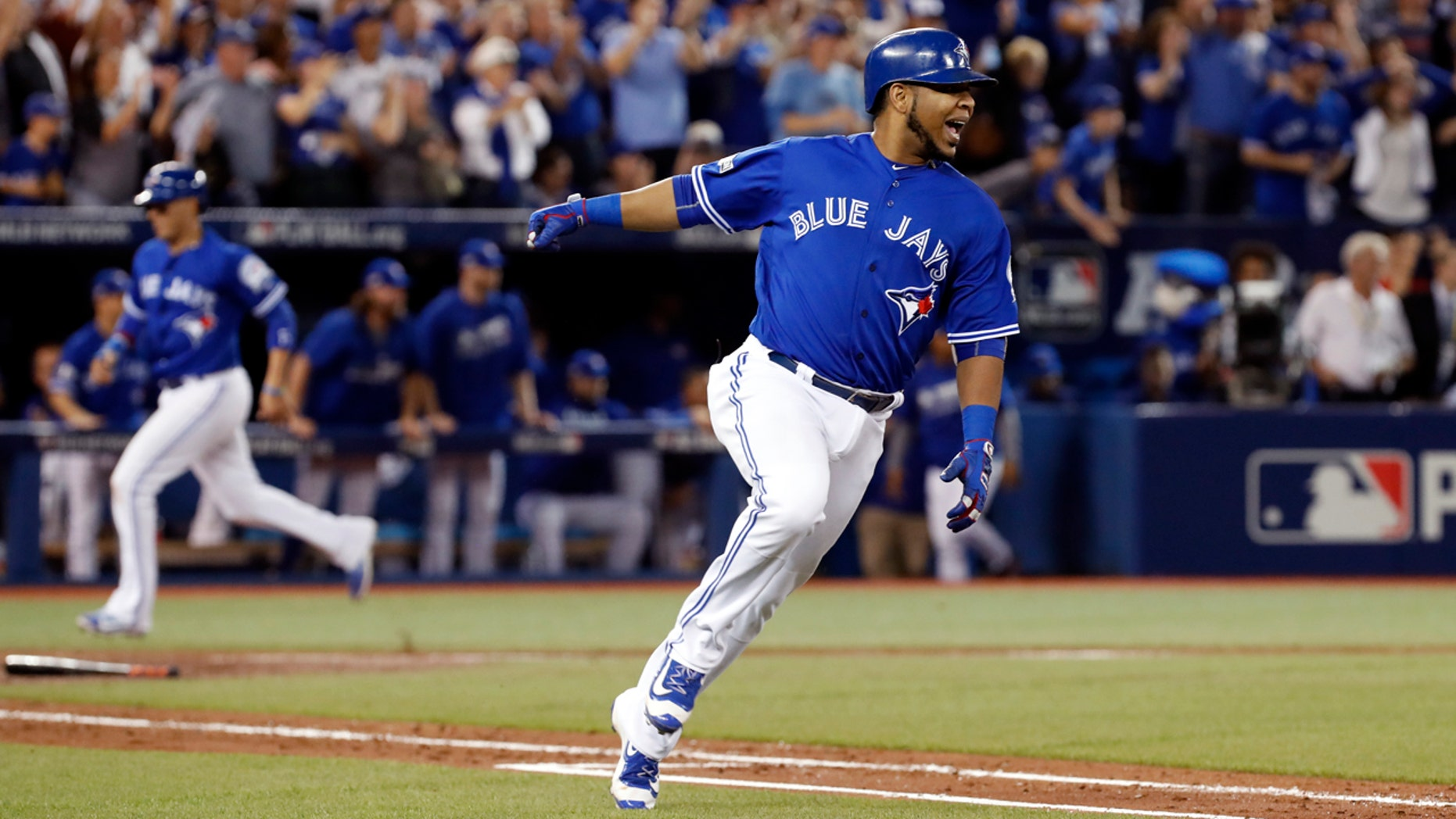 Oct. 18, 2016: Toronto Blue Jays' Edwin Encarnacion celebrates after his two-RBI double against the Cleveland Indians during the seventh inning in Game 4 of baseball's American League Championship Series in Toronto.