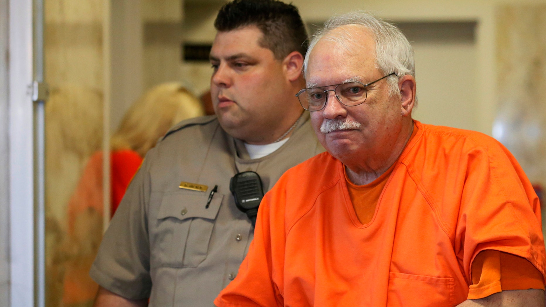 May 31, 2016: Robert Bates, a former Oklahoma volunteer sheriff's deputy who said he mistook his handgun for his stun gun when he fatally shot an unarmed suspect in 2015, is escorted from the courtroom following his sentencing at the courthouse in Tulsa.