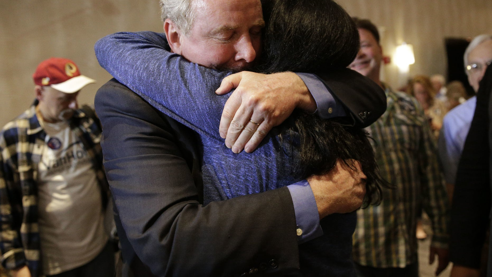 April 26, 2016: Democratic U.S. Senate candidate, Rep. Chris Van Hollen, D-Md., left, embraces supporter Carole Price after an election night party in Bethesda, Md.,