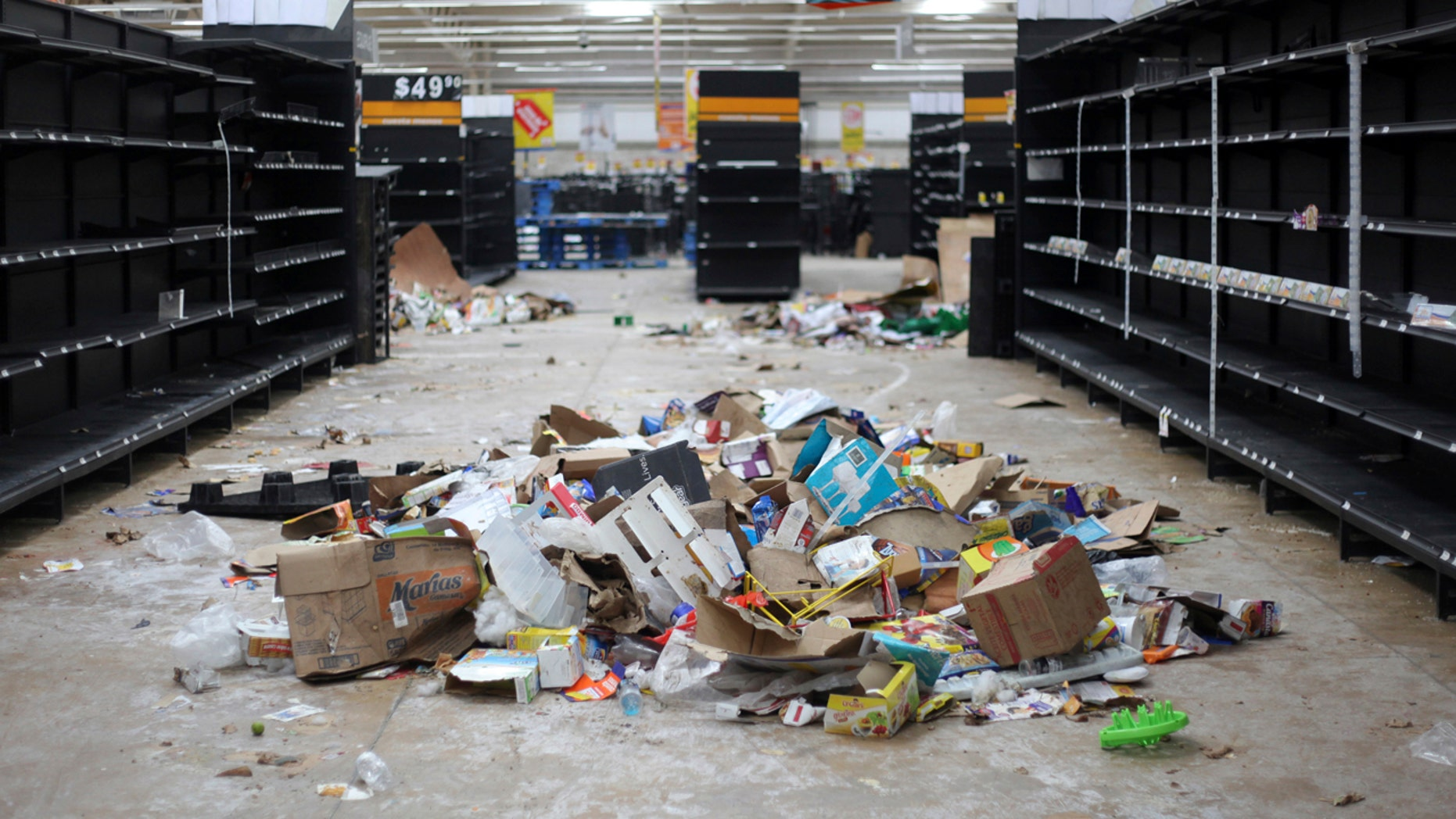 Supermarket displays stand empty and looted following protests caused by a 20 percent hike in gasoline prices, in Veracruz, Mexico, Saturday, Jan. 7, 2017.