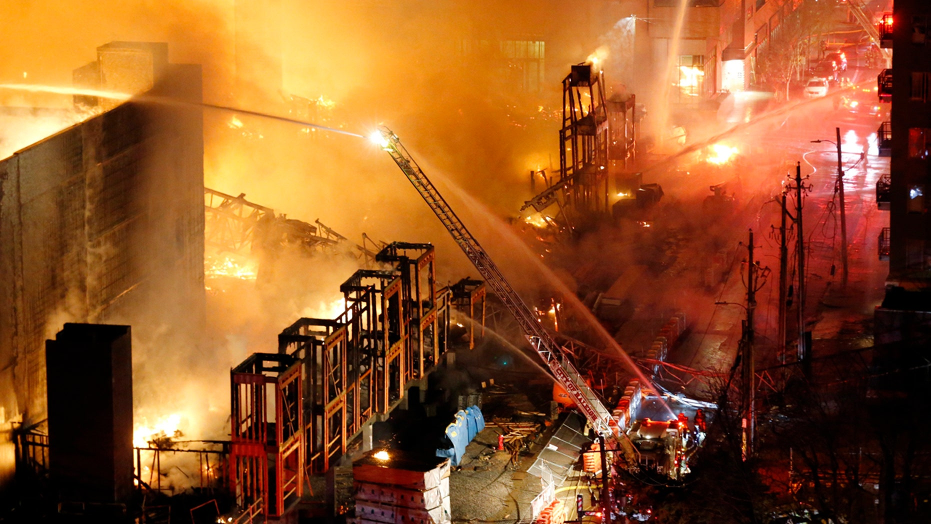 A large fire engulfed a building under construction in downtown Raleigh, N.C.   Thursday night, March 16, 2017.  A statement from the Raleigh Police Department says preliminary information indicates there were no injuries.