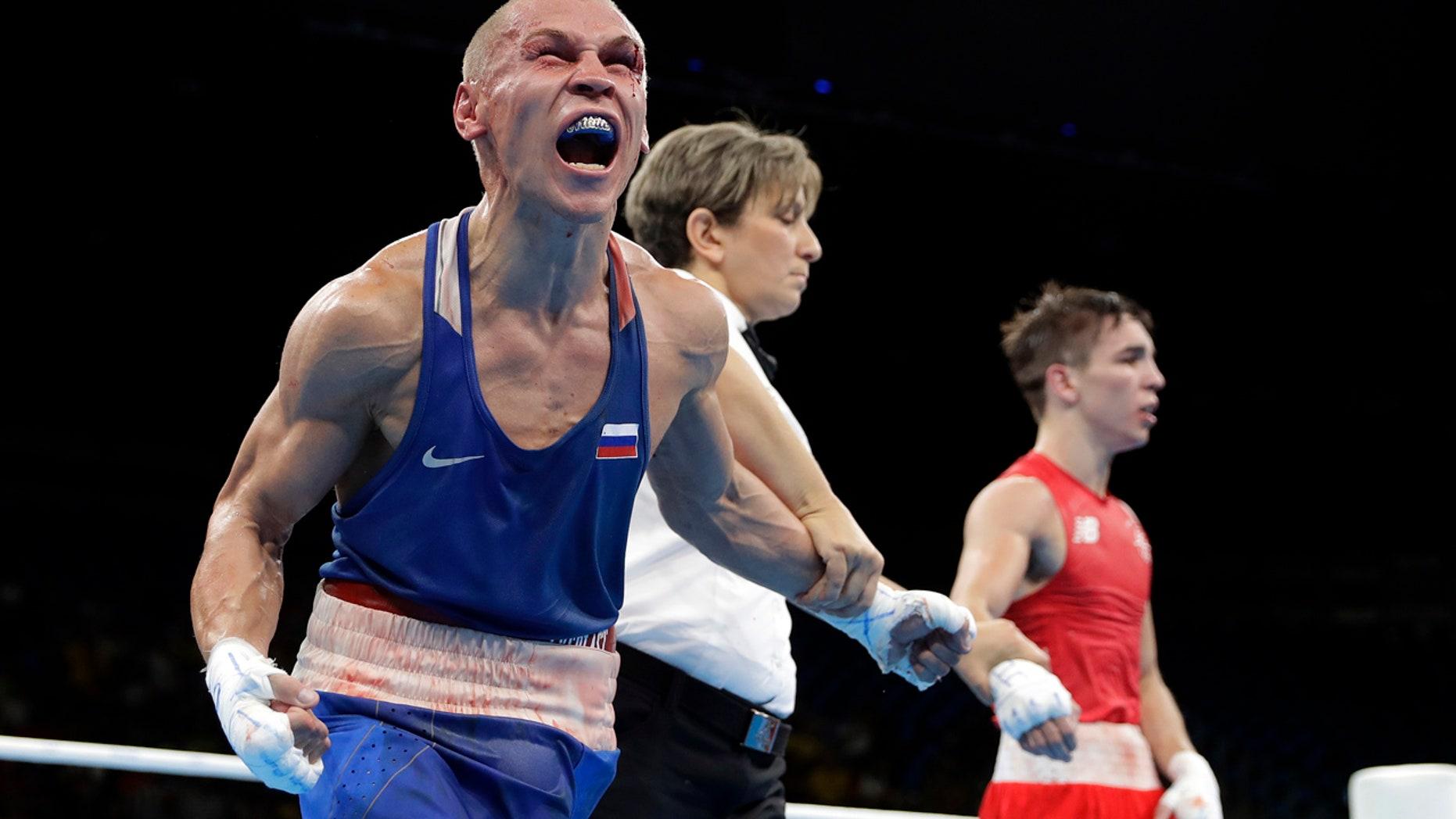Aug. 16, 2016: Russia's Vladimir Nikitin, left, reacts as he won a men's bantamweight 56-kg quarterfinals boxing match against Ireland's Michael John Conlan at the 2016 Summer Olympics in Rio de Janeiro, Brazil.
