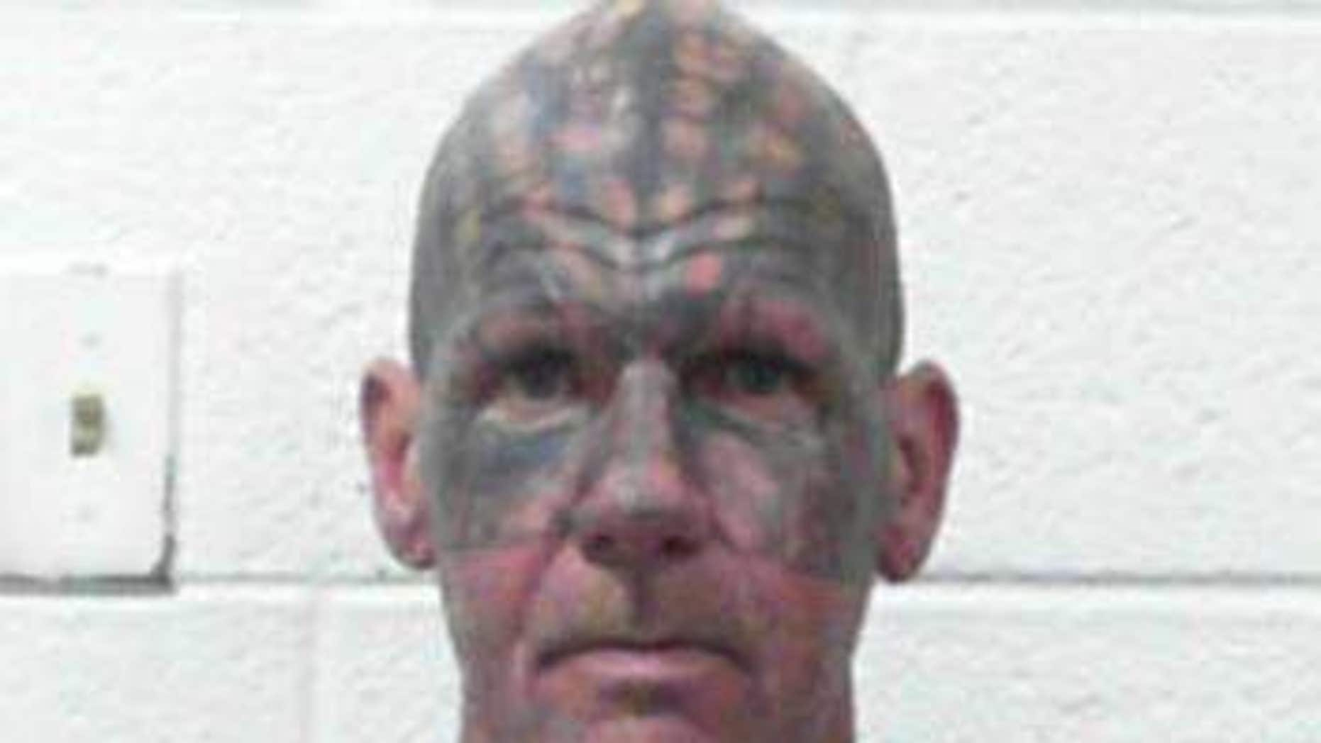 Ervin Franklin Harold, 51, allegedly held a woman against a wall and branded her multiple times, according to police.