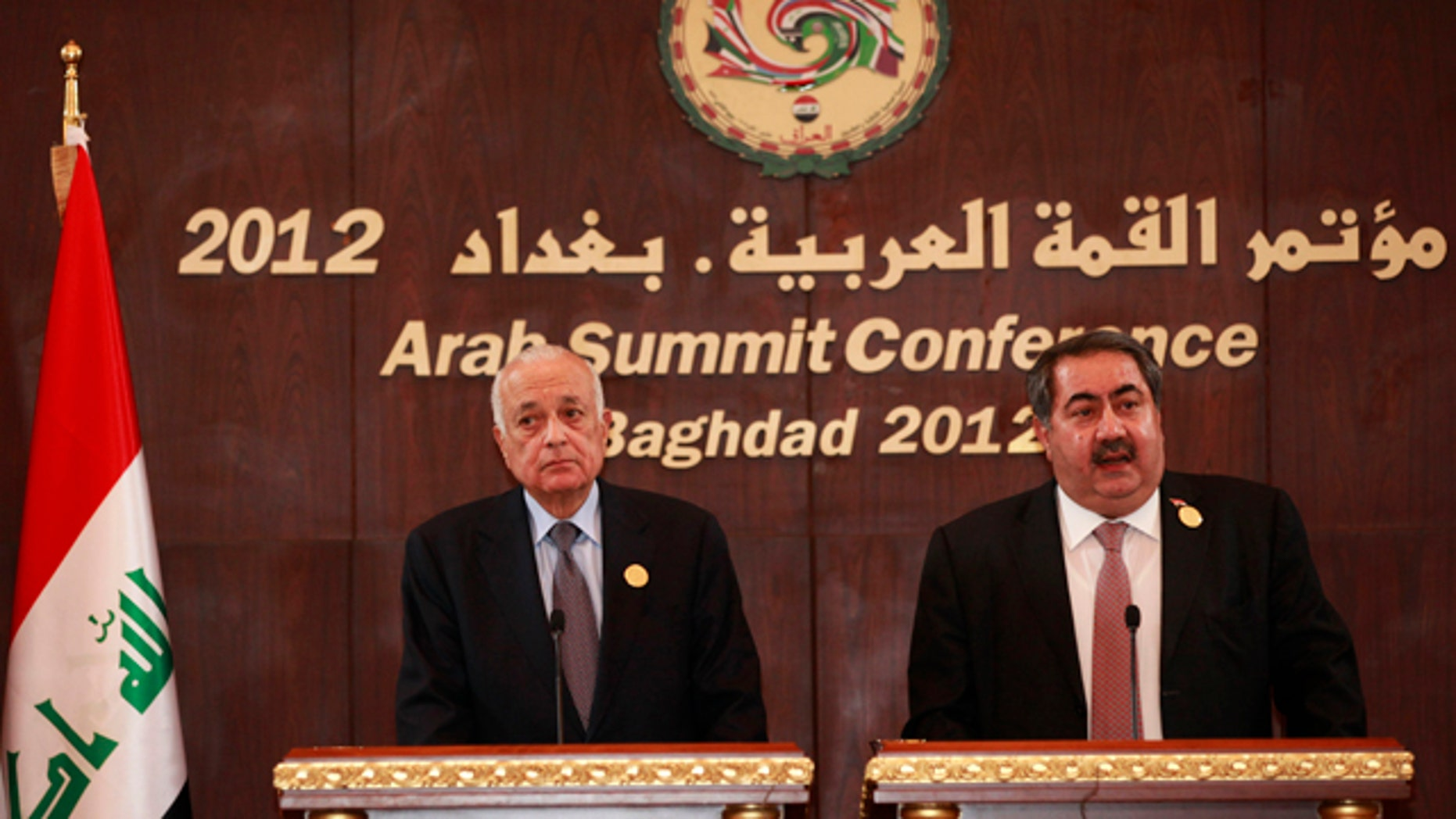 March 28, 2012: Arab League Secretary General Nabil Elaraby, left, and Iraqi Foreign Minister Hoshyar Zebari, right, hold a joint press conference in Baghdad, Iraq.