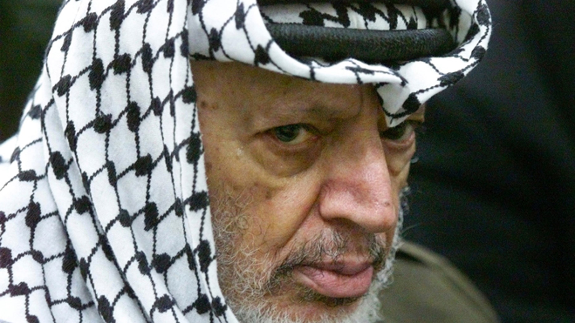 May 31, 2002: This photo shows Palestinian leader Yasser Arafat pauses during the weekly Muslim Friday prayers in his headquarters in the West Bank city of Ramallah.