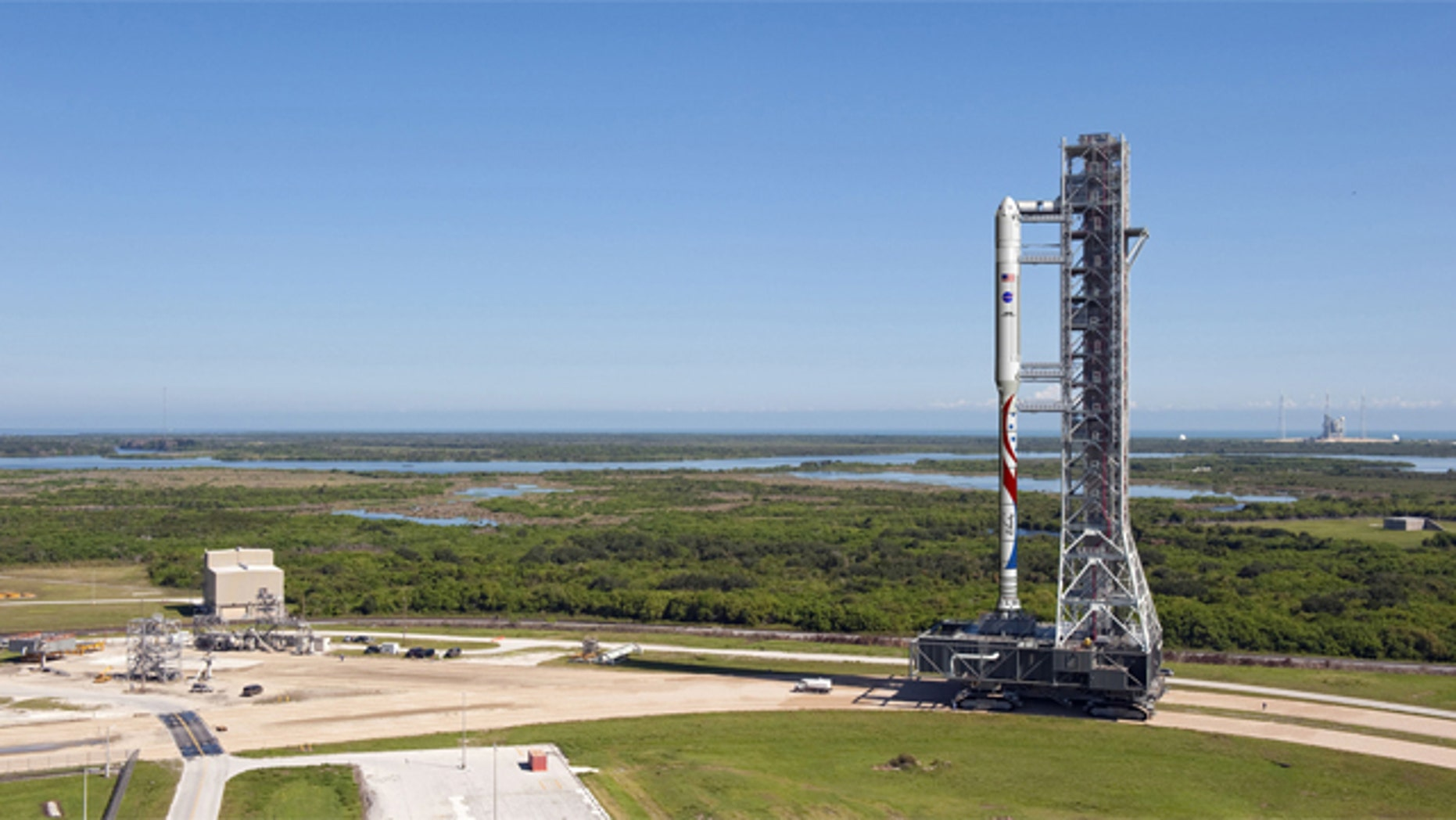The new Liberty launch vehicle, which draws on parts of NASA's cancelled Ares I rocket and Europe's Arian 5 rocket, will use existing infrastructure at Kennedy Space Center, such as the Mobile Launcher shown here in this illustration. The rocket proposal was developed by ATK and Astrium.
