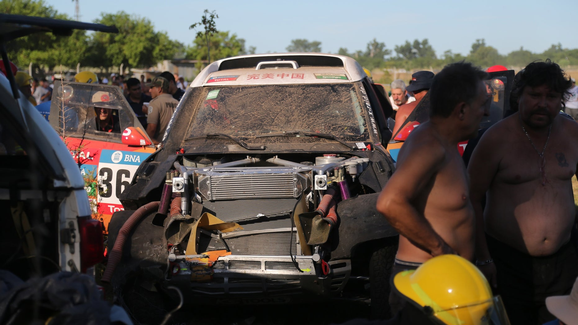 China's Guo Meiling's, X-Raid Team's damaged Mini, is seen after an accident in which at least 8 spectators were injured, during the Buenos Aires-Rosario prologue stage of the Dakar Rally 2016, in Arrecifes, Argentina, Saturday, Jan. 2, 2016. Guo Meiling is the first Chinese female driver to participate in the rally. (AP Photo/Jorge Saenz)