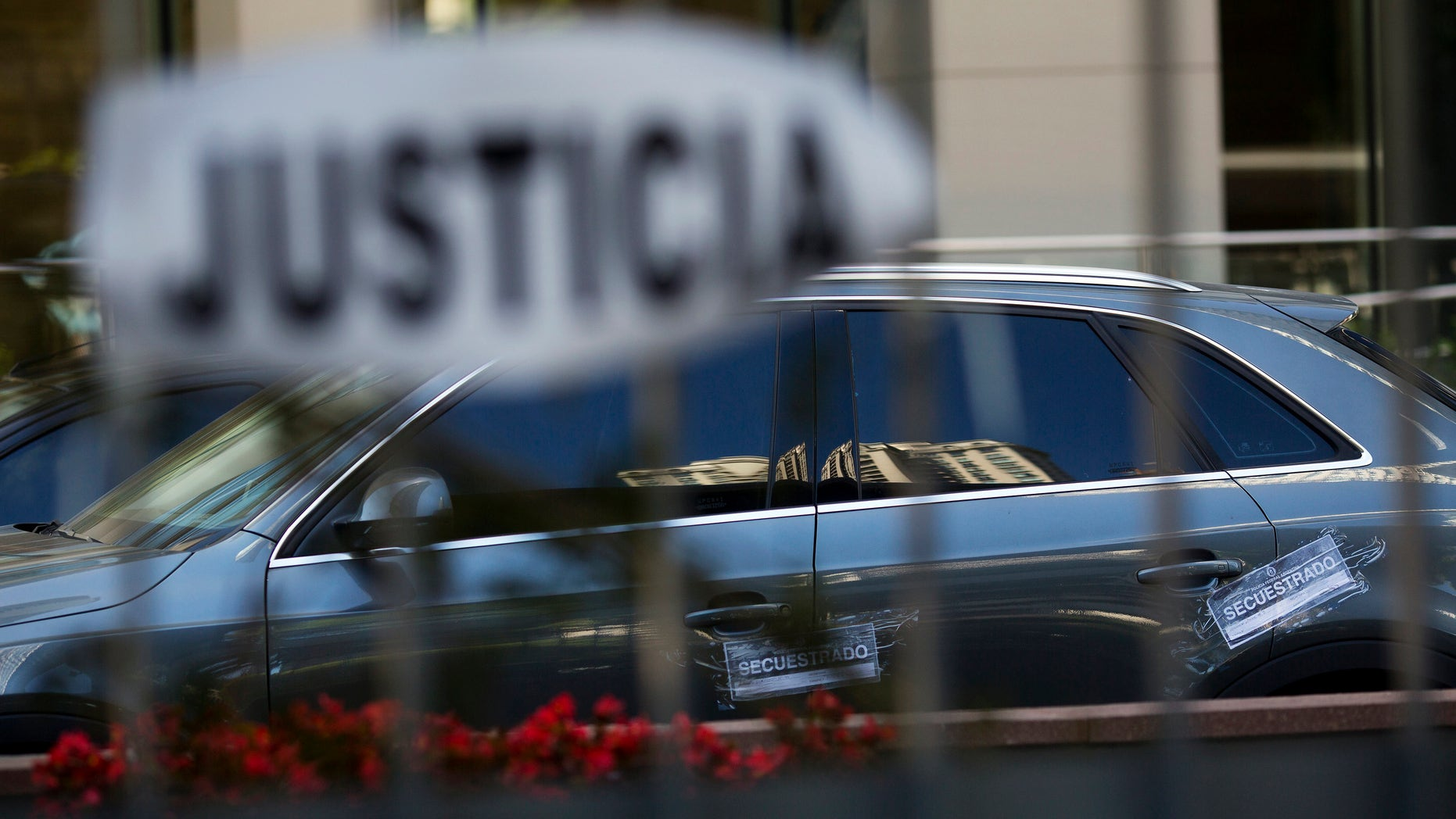 Vehicle impoundment notices are taped to the car of the late prosecutor Alberto Nisman, parked at Le Parc Tower, where Nisman lived on the 13th floor of the luxury condo, in Buenos Aires, Argentina, Thursday, Jan. 22, 2015. Argentine President Cristina Fernandez made an about-face Thursday, saying she now is âconvincedâ that Nismanâs death was not a suicide just days after she suggested the man who accused her of a cover-up in the nationâs worst terrorist attack had killed himself. (AP Photo/Rodrigo Abd)