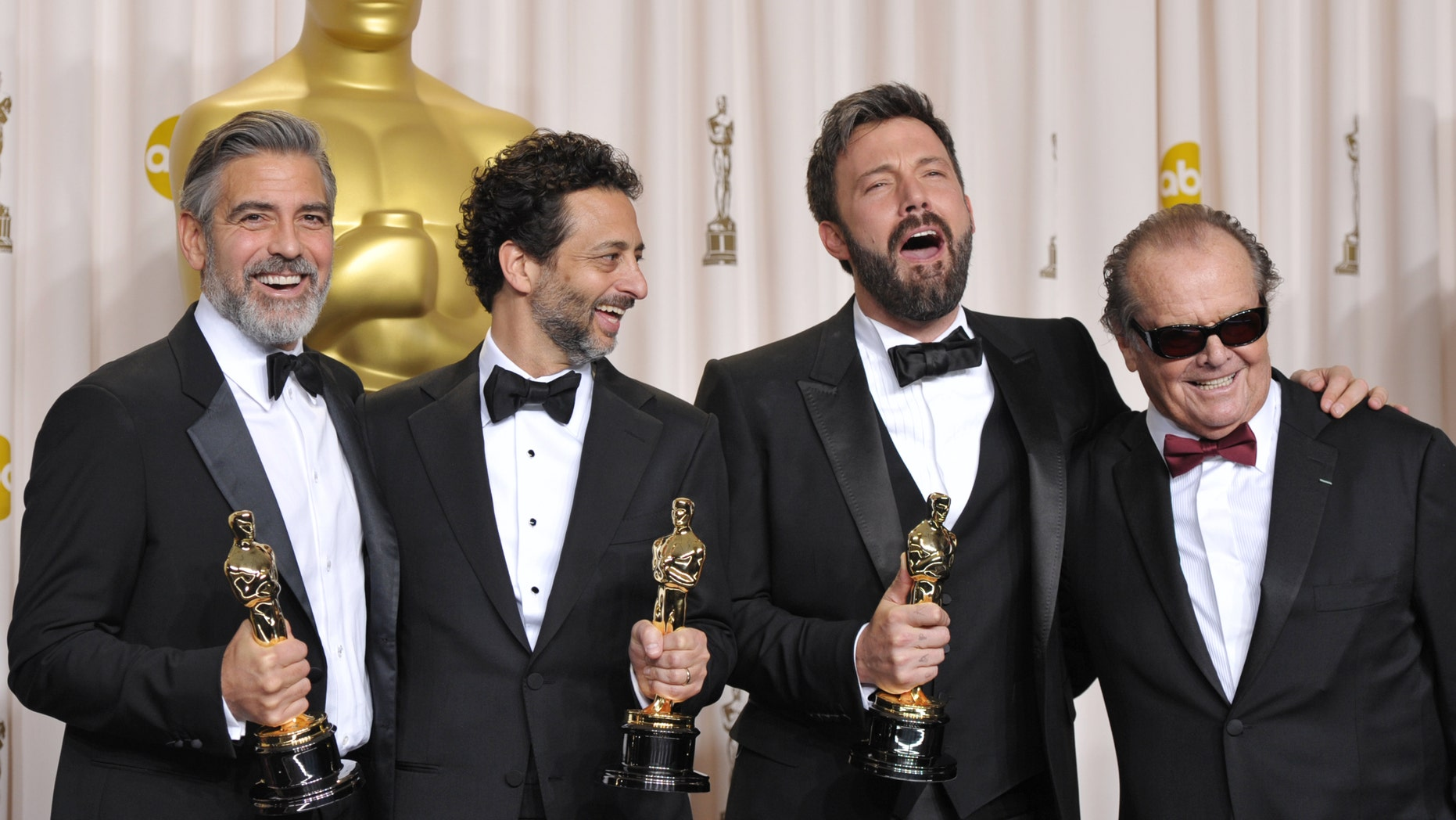 """George Clooney, from left, Grant Heslov, Ben Affleck pose with their award for best picture for """"Argo"""" pose with presenter Jack Nicholson, right, during the Oscars at the Dolby Theatre on Sunday Feb. 24, 2013, in Los Angeles. (Photo by John Shearer/Invision/AP)"""