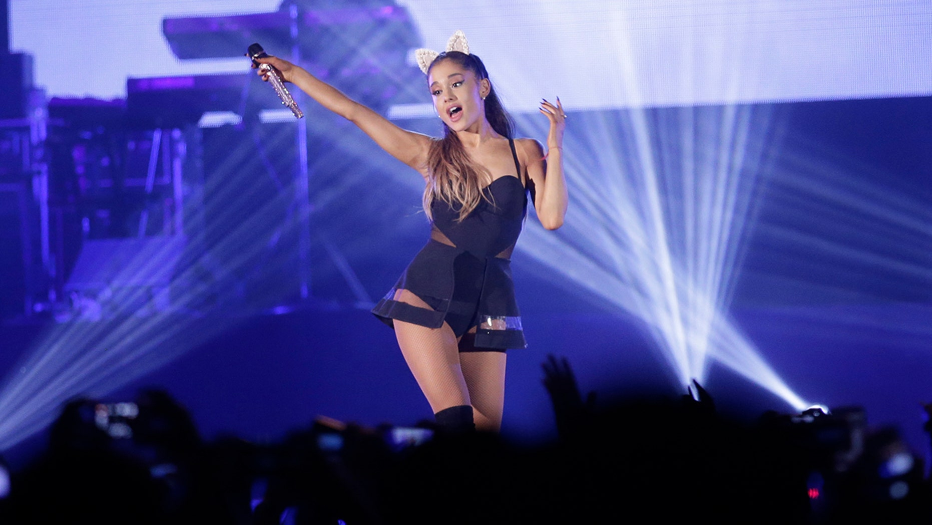 In this Aug. 26, 2015 file photo, Ariana Grande performs during the honeymoon tour concert in Jakarta, Indonesia. Authorities in Costa Rica said on Monday, July 10 2017 they have arrested a 22-year-old Colombian man suspected of threatening to stage an attack at a concert by pop singer.
