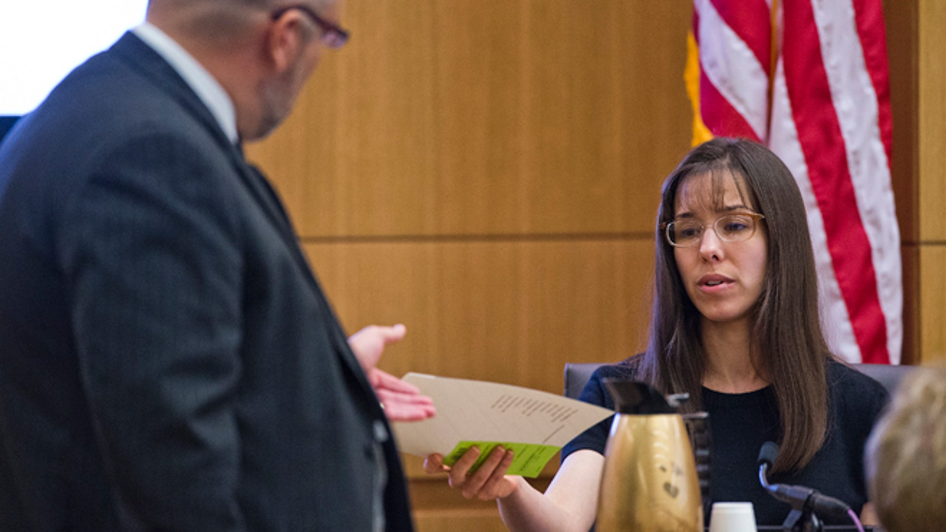 March 4, 2013: Jodi Arias, right,  is questioned during redirect from defense attorney Kirk Nurmi, left, in Maricopa County Superior Court in downtown Phoenix.  Arias is on trial for the murder of Travis Alexander in 2008.