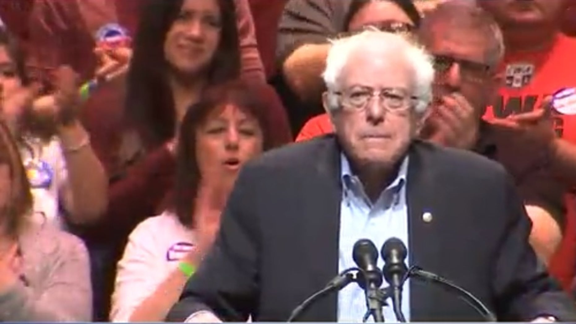 Vermont Independent Sen. Bernie Sanders took the podium in front of thousands of people at his rally in downtown Phoenix.