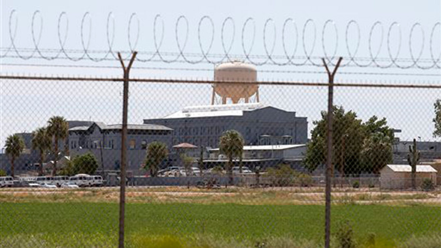 In this file photo a fence surrounds the state prison in Florence, Ariz.