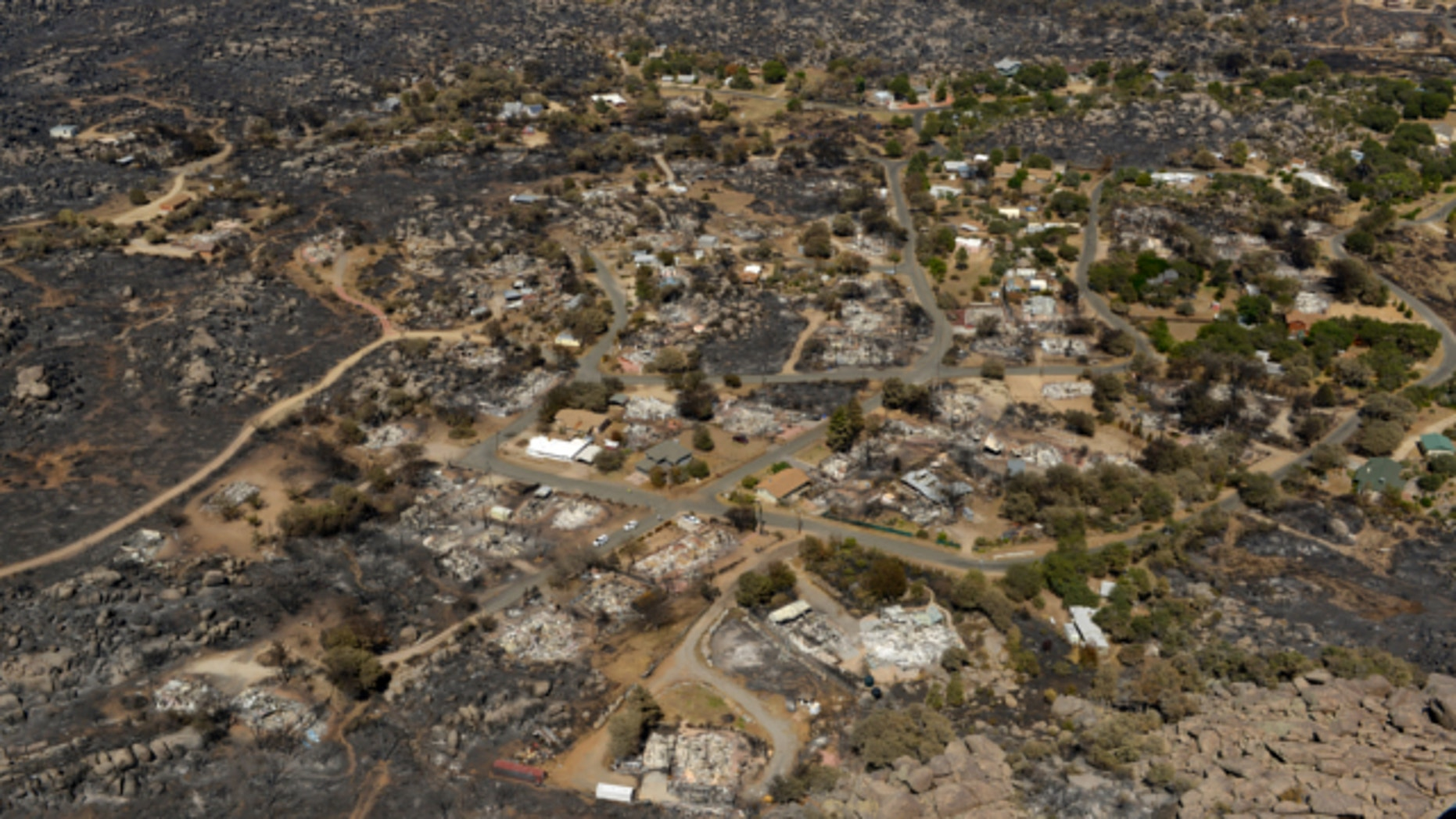 July 7, 2013: Several homes are seen destroyed by fire in Yarnell, Ariz.