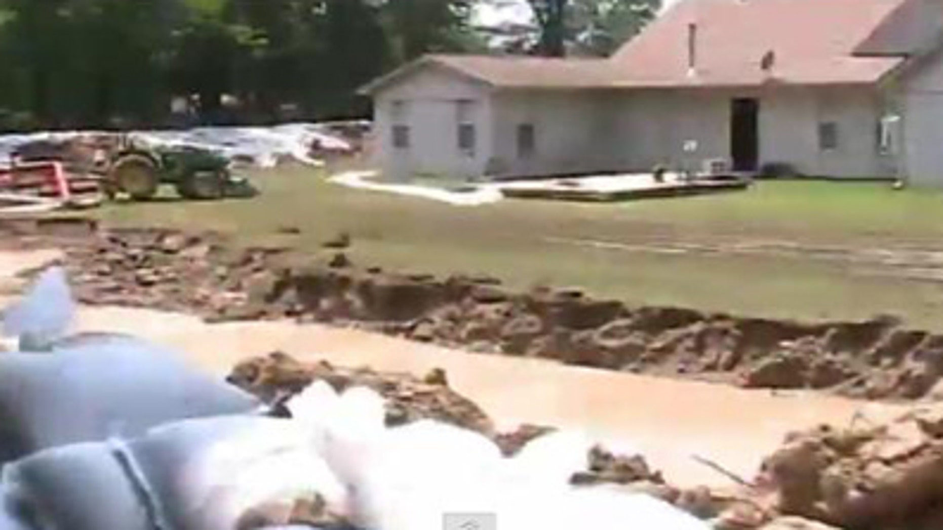 Russell Petty of Devalls Bluff, Ark., has built a moat and levee to protect his property from rising floodwaters.