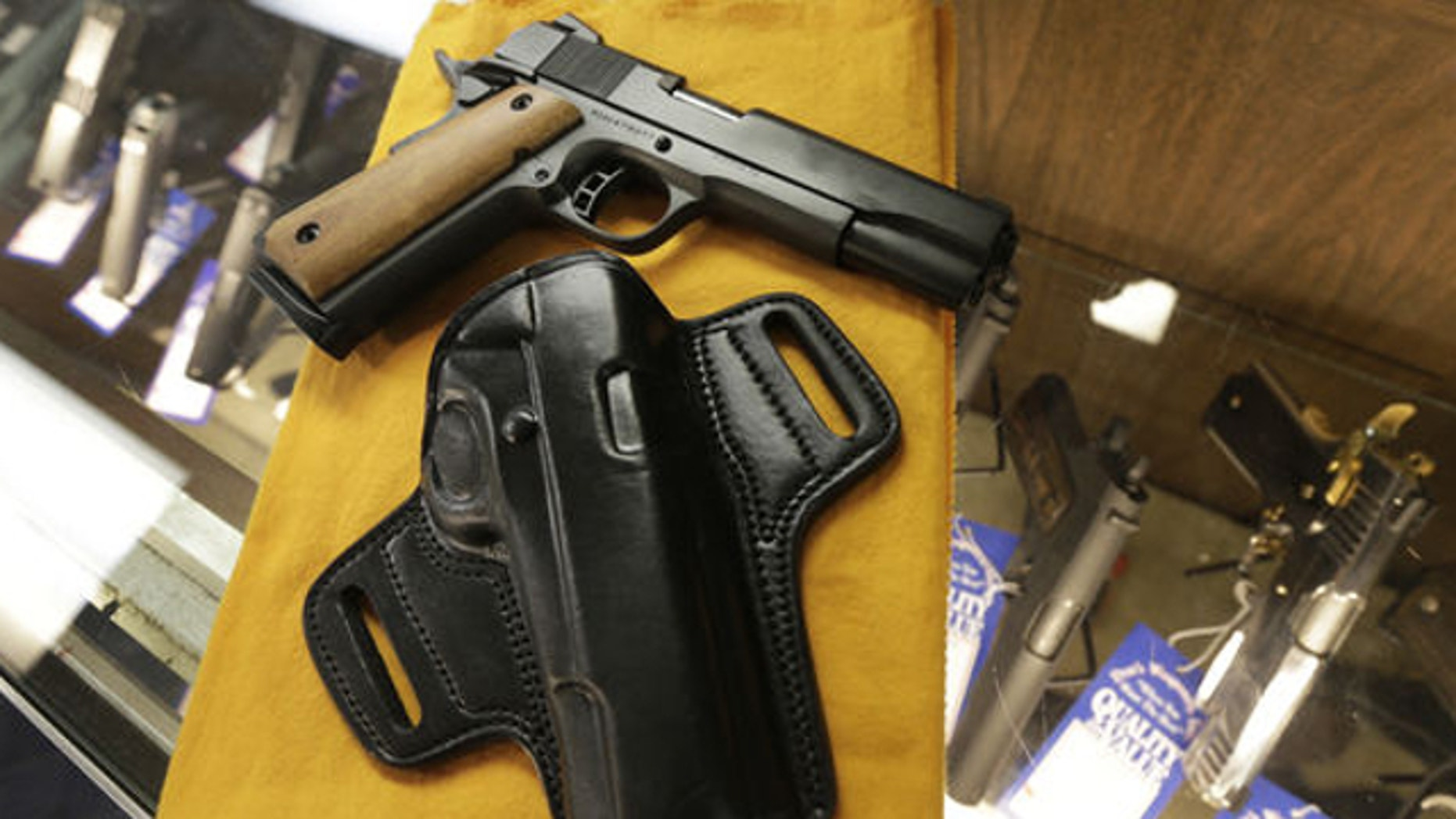 Aug. 24, 2013: A semi-automatic handgun and a holster are displayed at a North Little Rock, Ark., gun shop Thursday, Aug. 22, 2013. A march by by advocates of open carrying of guns is planed for Saturday in Fort Smith, Ark.