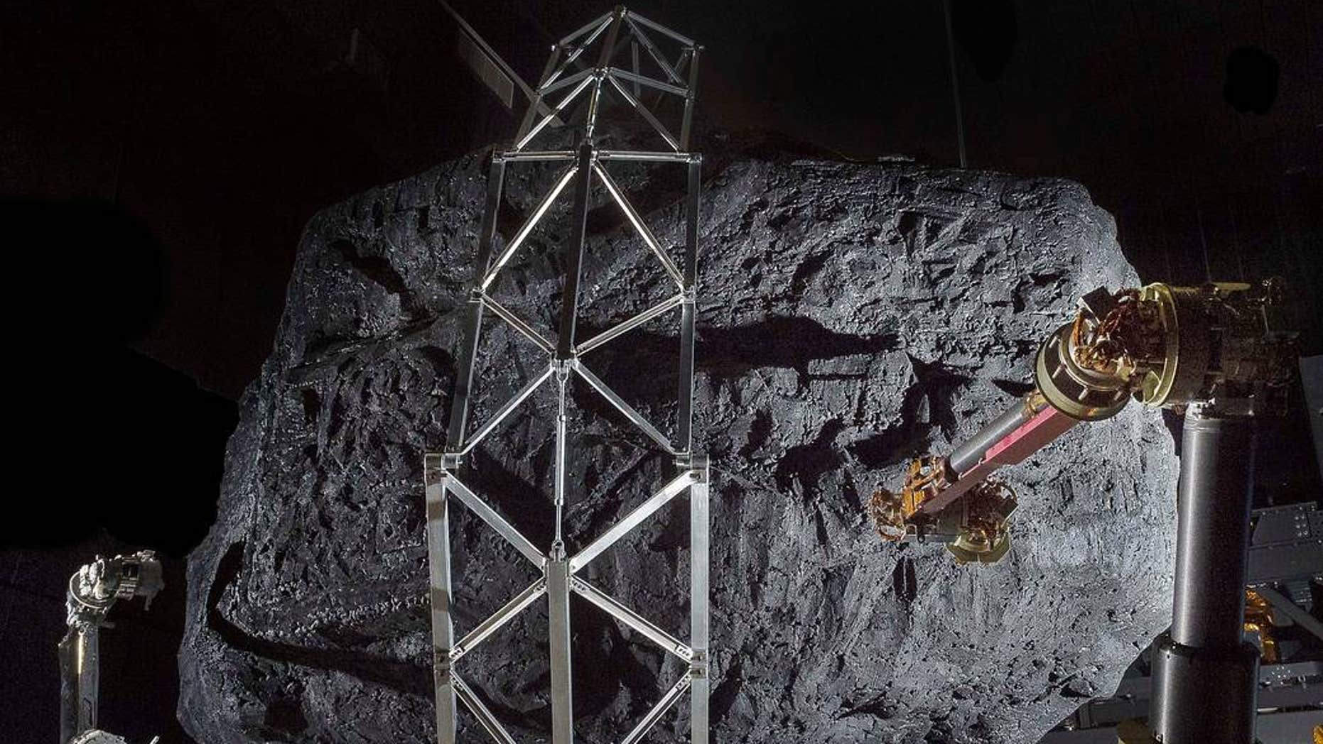 In preparation for the 2021 Asteroid Redirect Mission, this prototype of a robotic capture module system uses a mock asteroid boulder as a test at the Goddard Space Flight Center in Greenbelt, Maryland. (Credit: NASA)