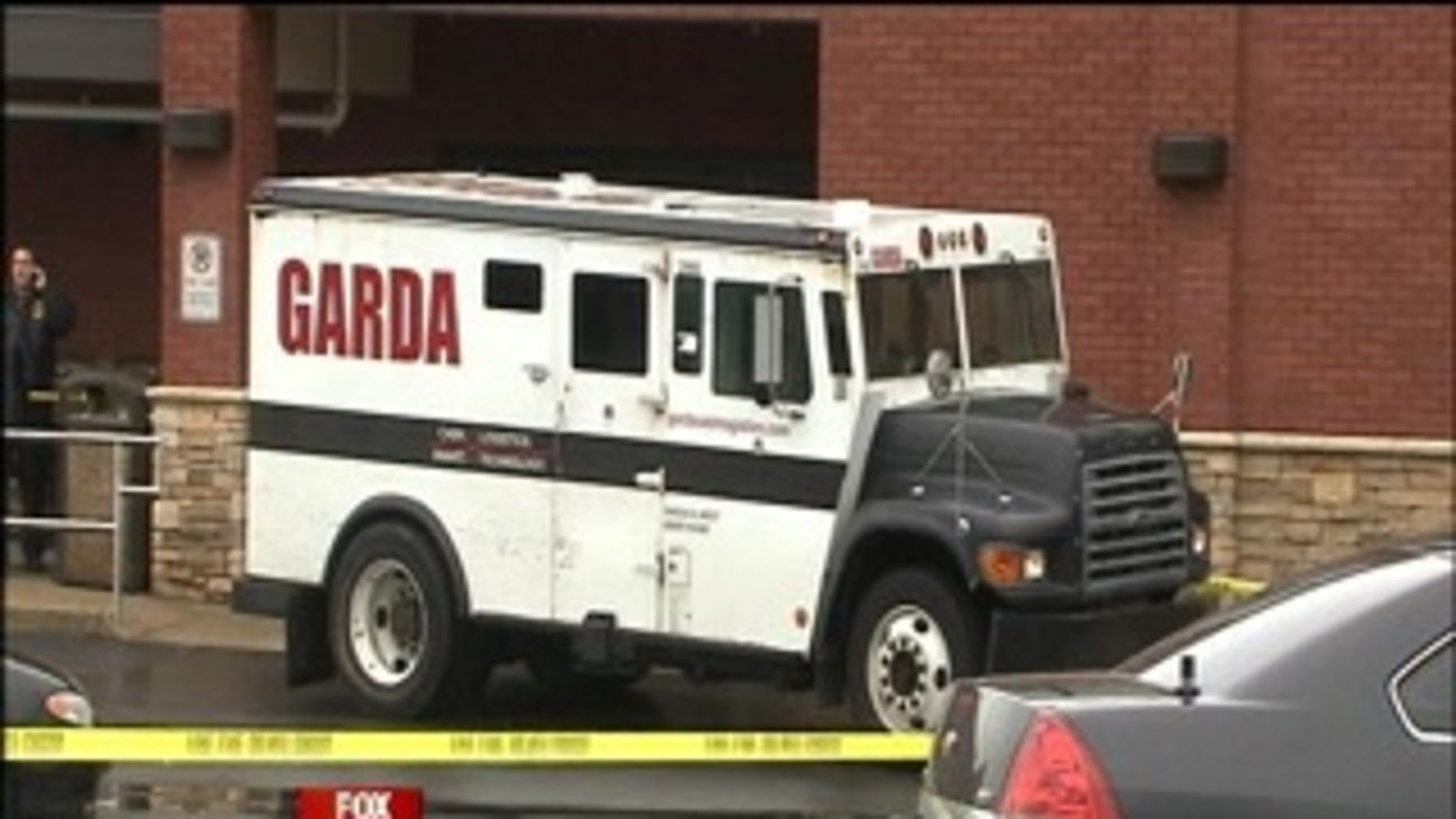 Authorities say an armored car worker who had just made a pickup at a Georgia grocery store was shot several times and robbed as he left the store.