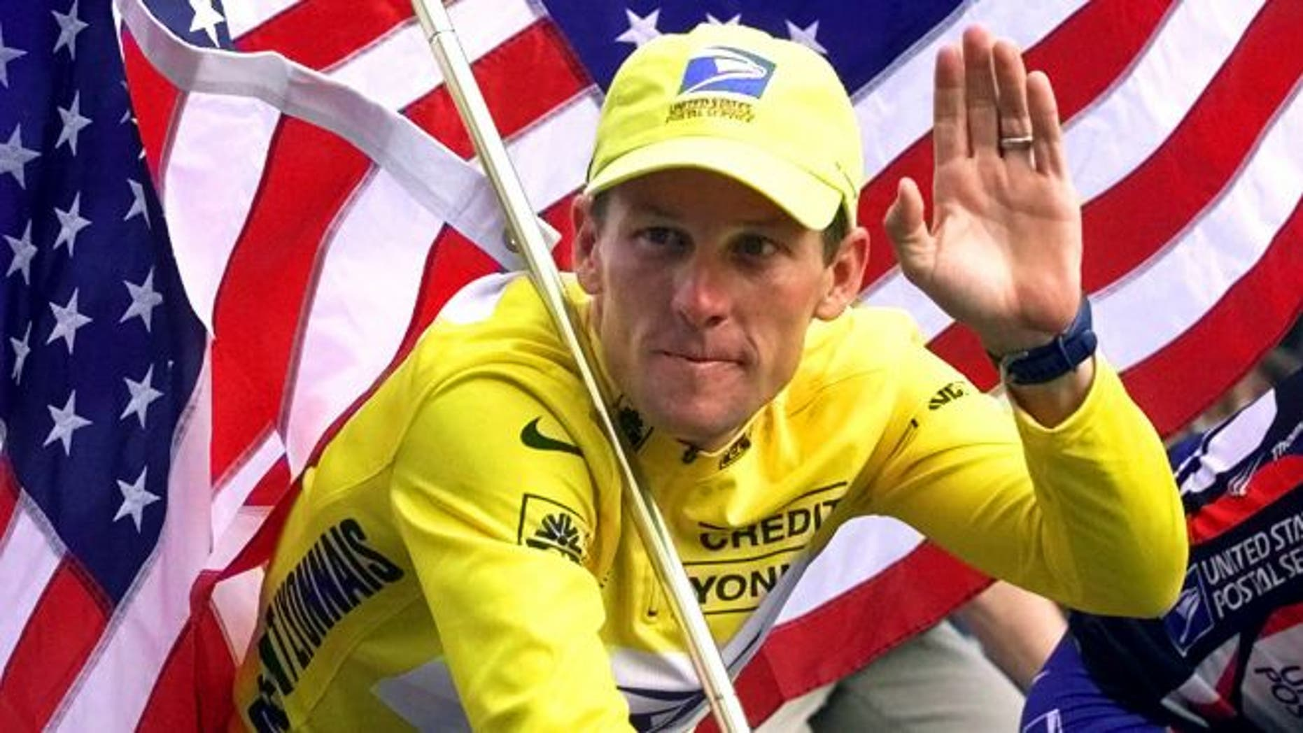 July 23, 2000: Lance Armstrong rides down the Champs Elysees after the final stage of the Tour de France cycling race in Paris.