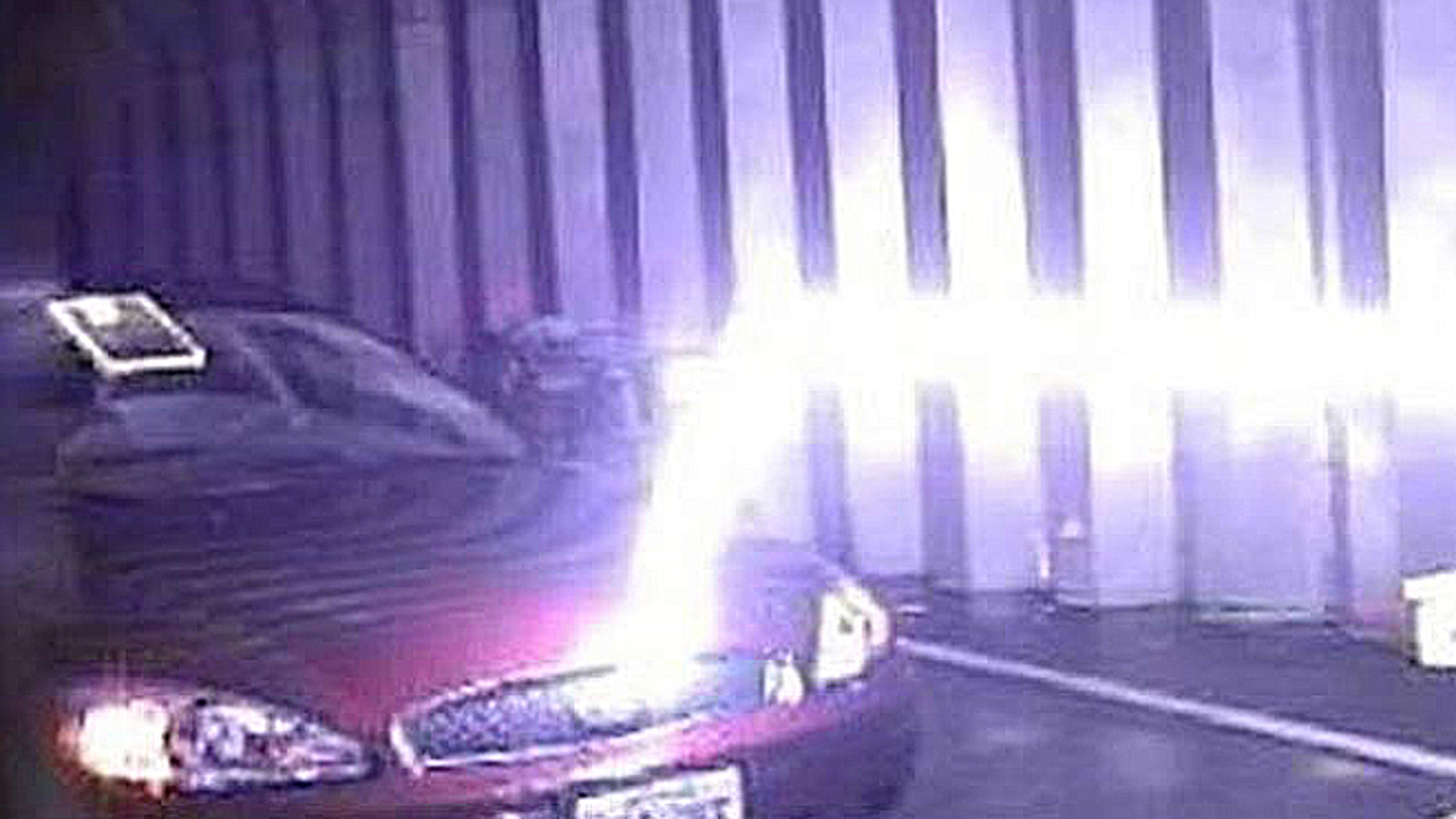 A guided lightning bolt travels horizontally, then hits a car when it finds the lower resistance path to ground in a U.S. Army test.