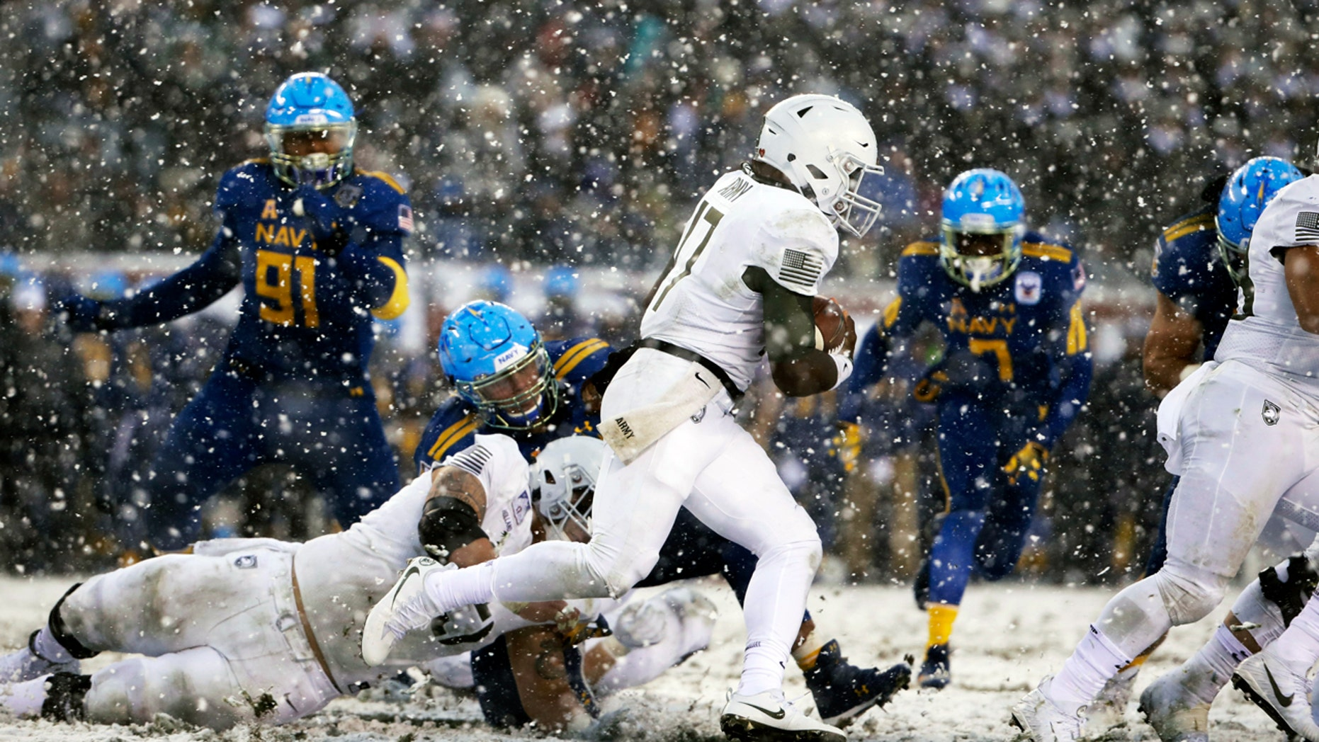Army quarterback Ahmad Bradshaw runs the ball against Navy during the first half of Saturday's Army-Navy game in Philadelphia