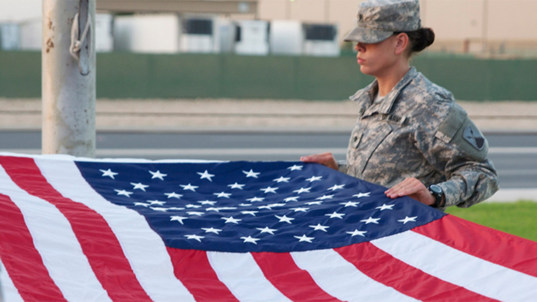 A Soldier on flag detail prepares to fold Old Glory. (U.S. Army/Sgt. John Carkeet IV)