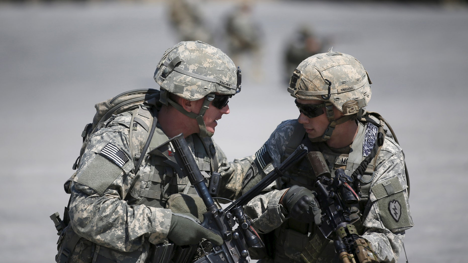File photo - U.S. Army soldiers take part in a U.S.-South Korea joint live-fire military exercise at a training field in Pocheon, south of the demilitarized zone separating the two Koreas, March 25, 2015.