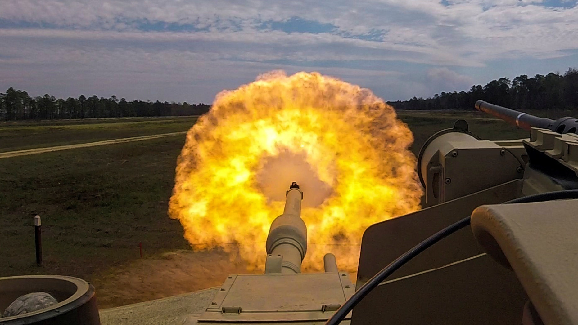 File photo - Troopers with the U.S. Army 2nd Armored Brigade Combat Team, 3rd Infantry Division fire the main gun round at a target during unit gunnery practice with newly acquired M1A1-SA Abrams tanks at Fort Stewart, Georgia, U.S. March 29, 2018. Picture taken March 29, 2018. (U.S. Army/Handout via REUTERS)