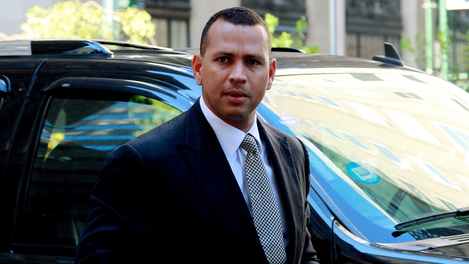 This Oct. 1, 2013 photo shows New York Yankees' Alex Rodriguez arriving at the offices of MLB in New York.