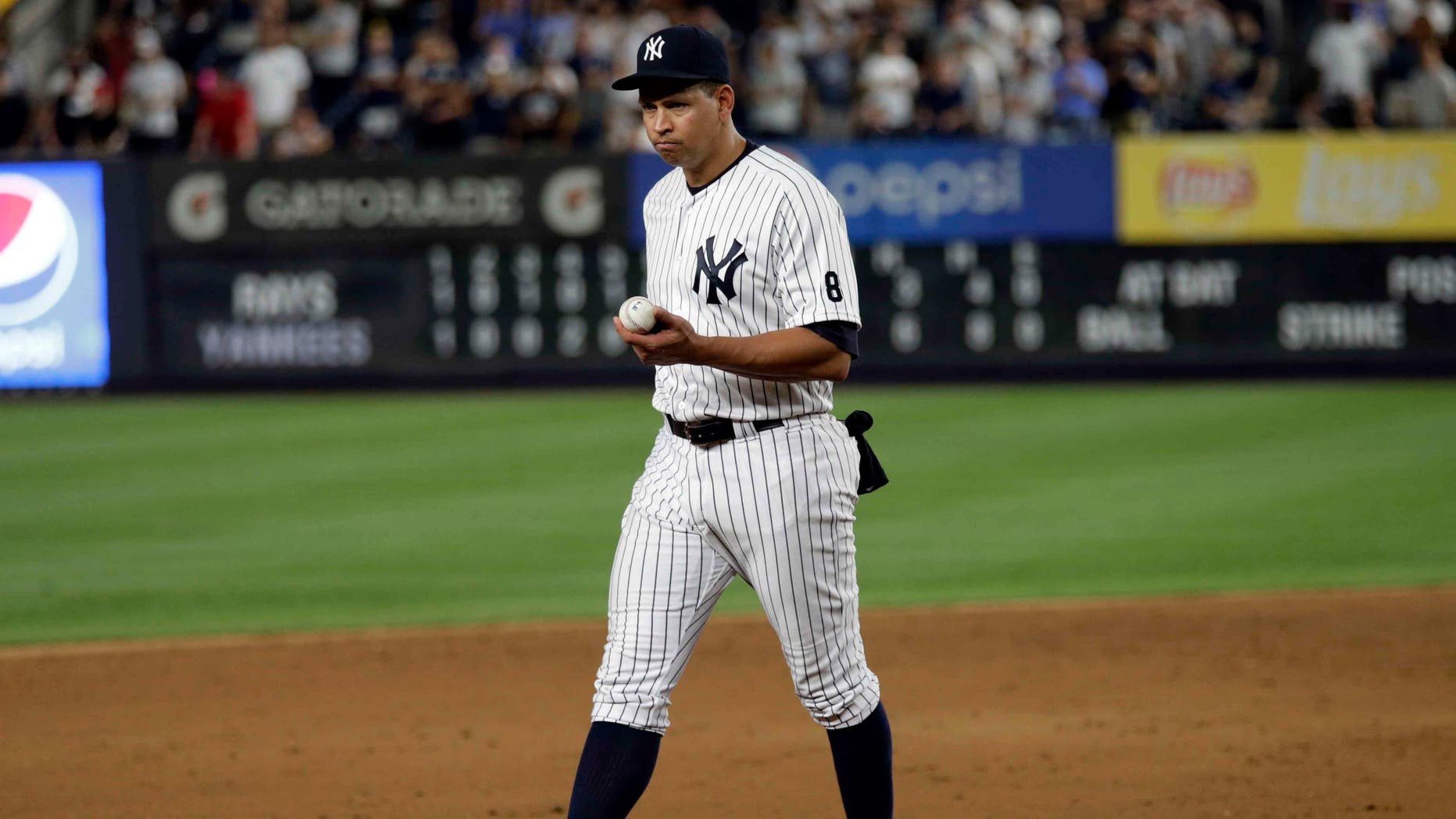 Alex Rodriguez walks towards third base in his final game as a Yankee player, Friday, Aug. 12, 2016, in New York.
