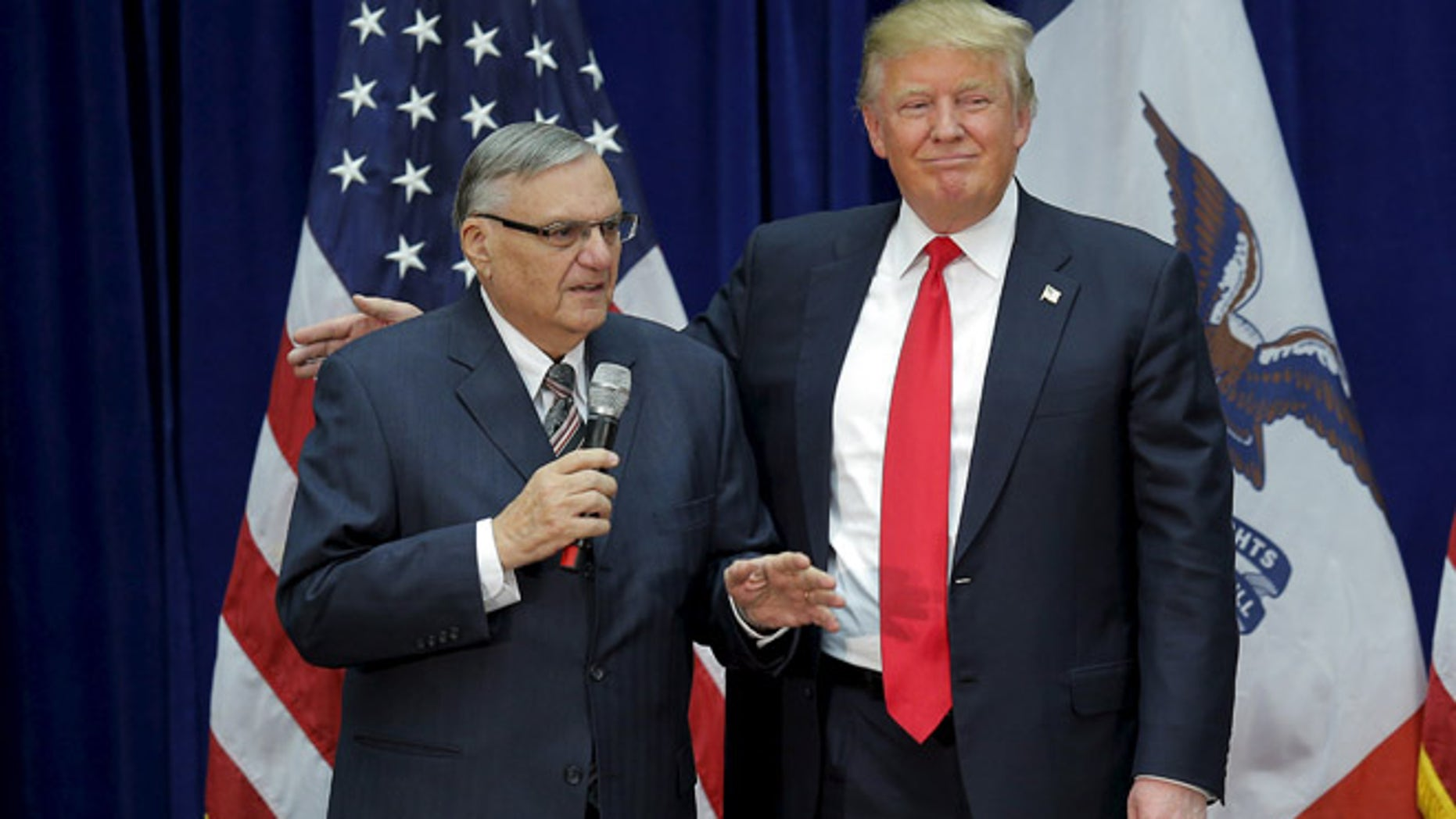 In this Jan. 26, 2016 photo, Donald Trump is joined onstage by then-Maricopa County Sheriff Joe Arpaio at a campaign rally in Marshalltown, Iowa.
