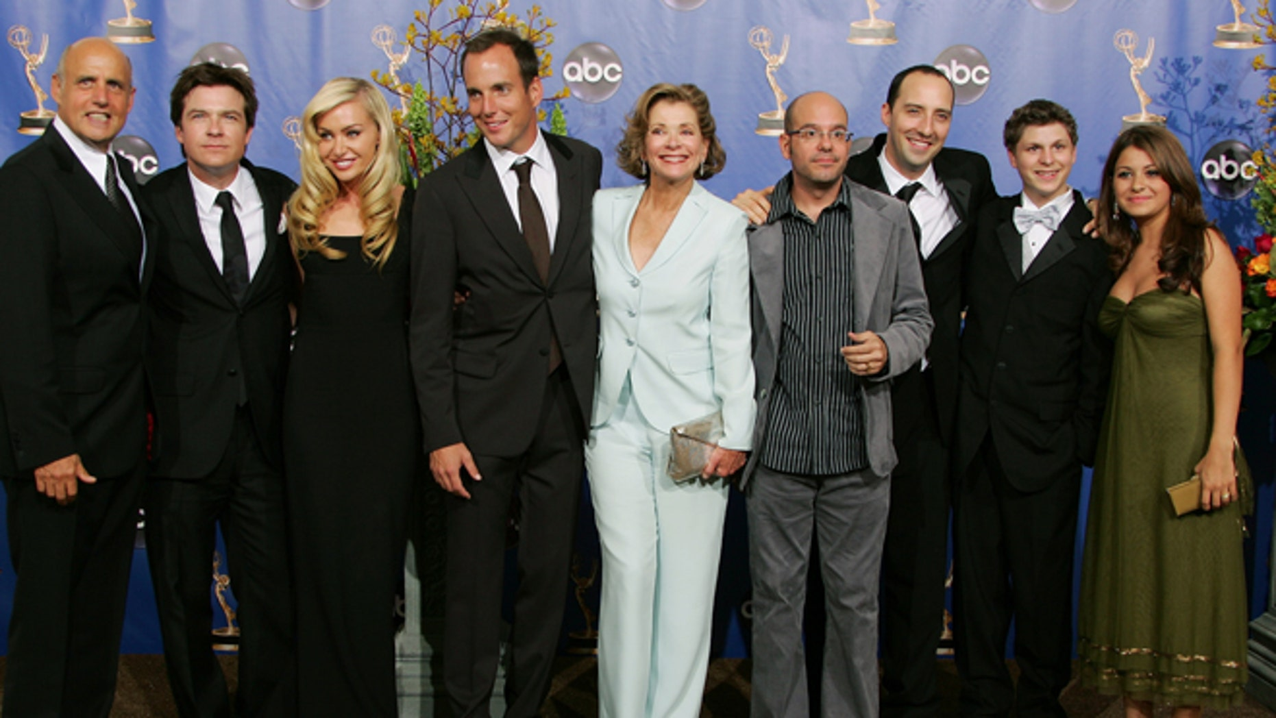 "The Cast of ""Arrested Development"" smile at the 56th annual Primetime Emmy Awards in Los Angeles, September 19, 2004."