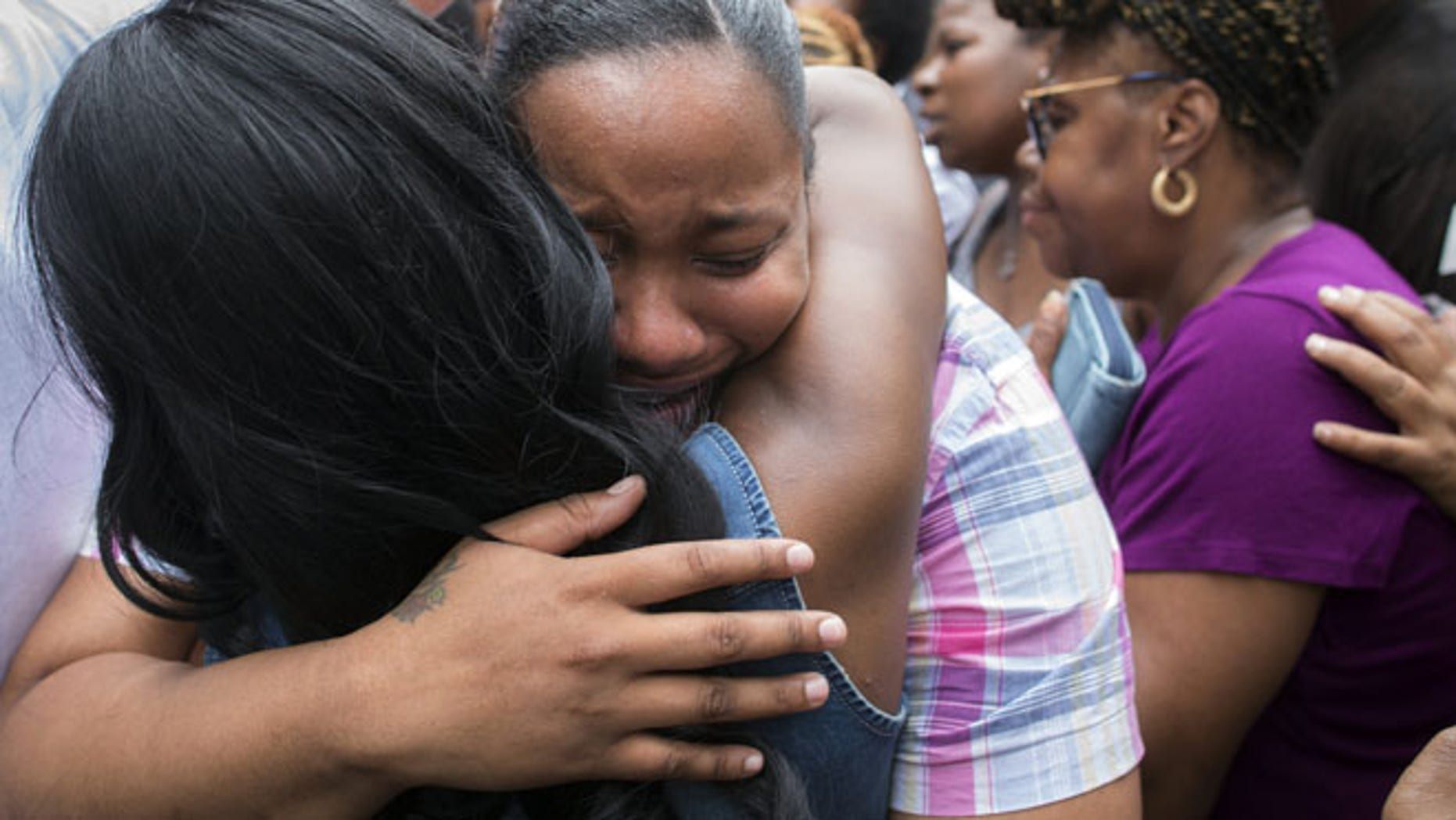 July 19, 2014: Emerald Garner, daughter of Eric Garner, mourns at the site of her father's death on a march following a service held in his name at the Mount Sinai Center for Community Enrichmen in the Staten Island borough of New York. (AP)
