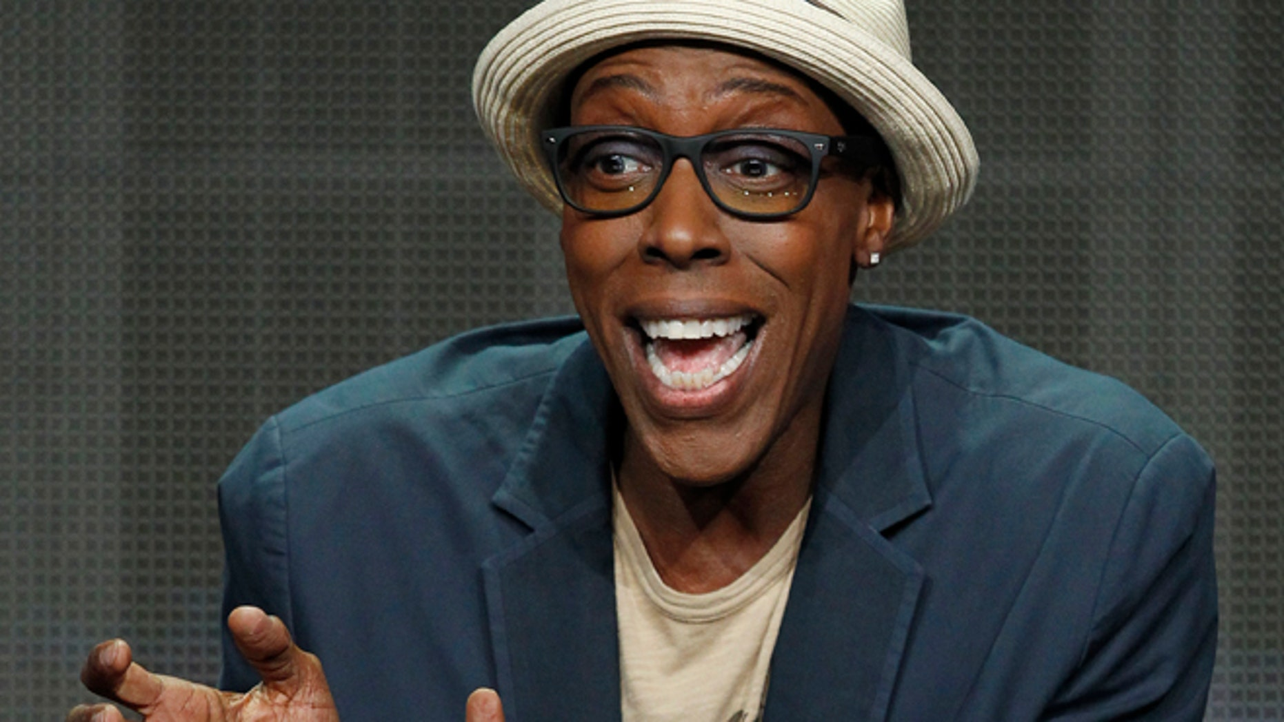 """Host and executive producer Arsenio Hall speaks at a panel for the television series """"The Arsenio Hall Show"""" during the CBS portion of the Television Critics Association Summer press tour in Beverly Hills, California July 29, 2013.  REUTERS/Mario Anzuoni (UNITED STATES - Tags: ENTERTAINMENT) - RTX124AV"""