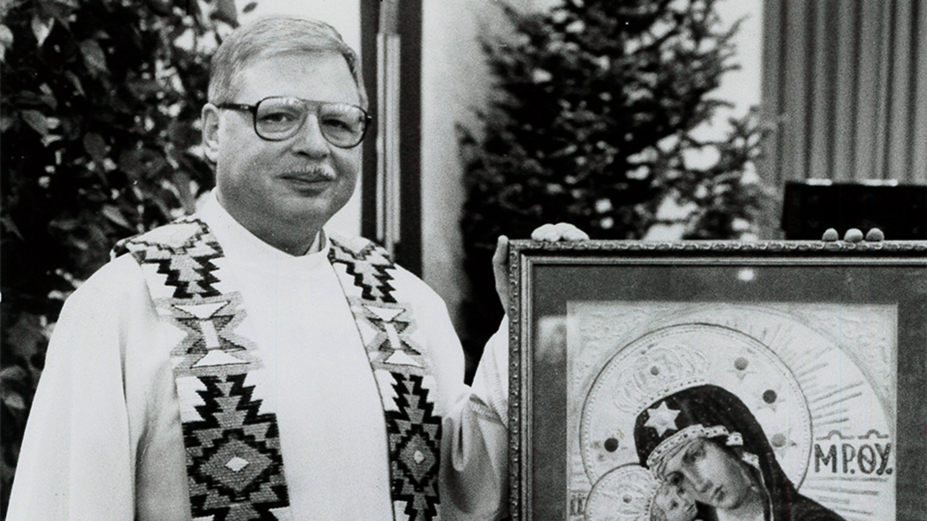 This 1989 file photo shows Father Arthur Perrault in Albuquerque, N.M.