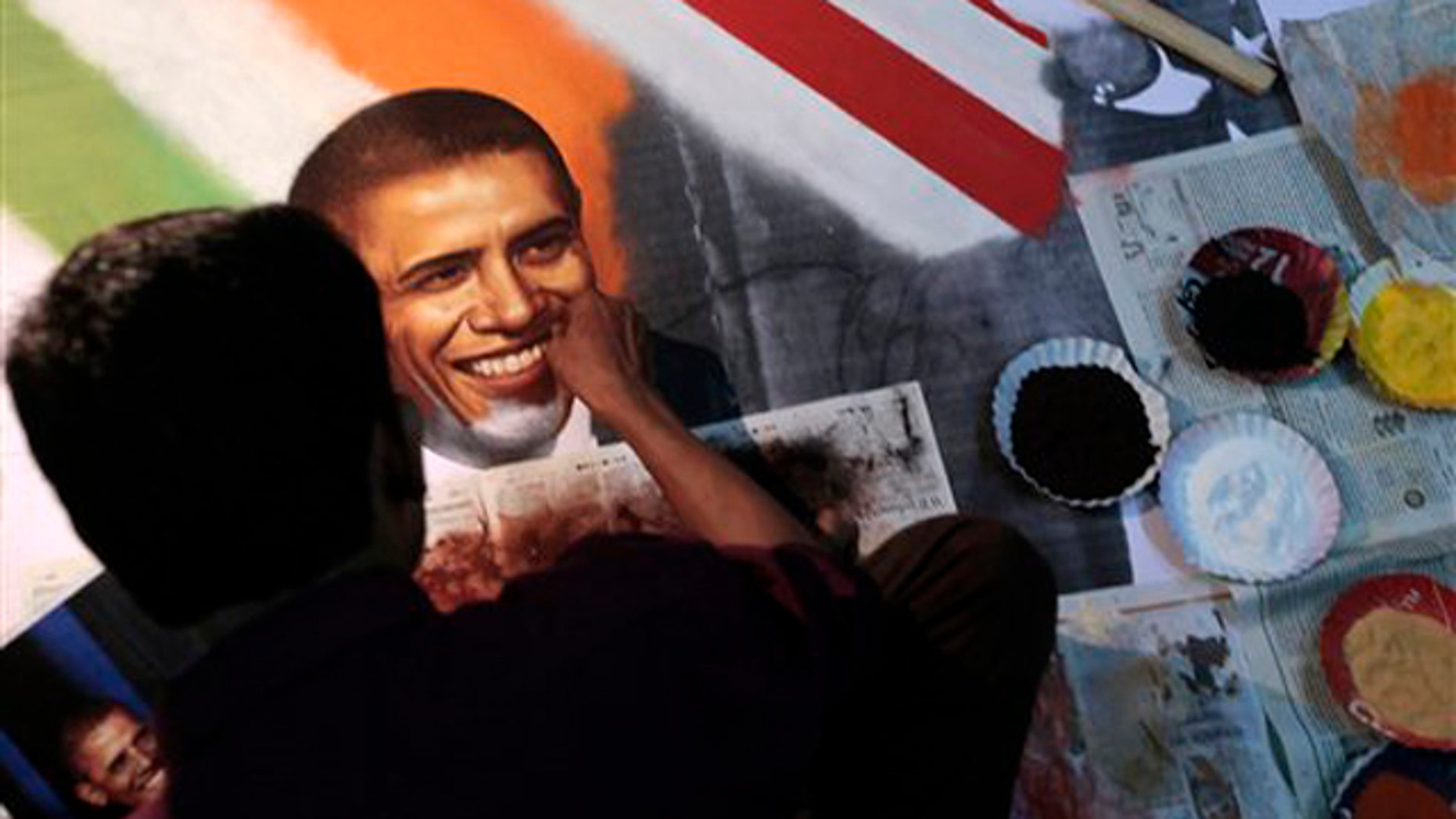 Nov. 4: An Indian artist makes an art piece depicting President Obama at a studio in Thane, near Mumbai.