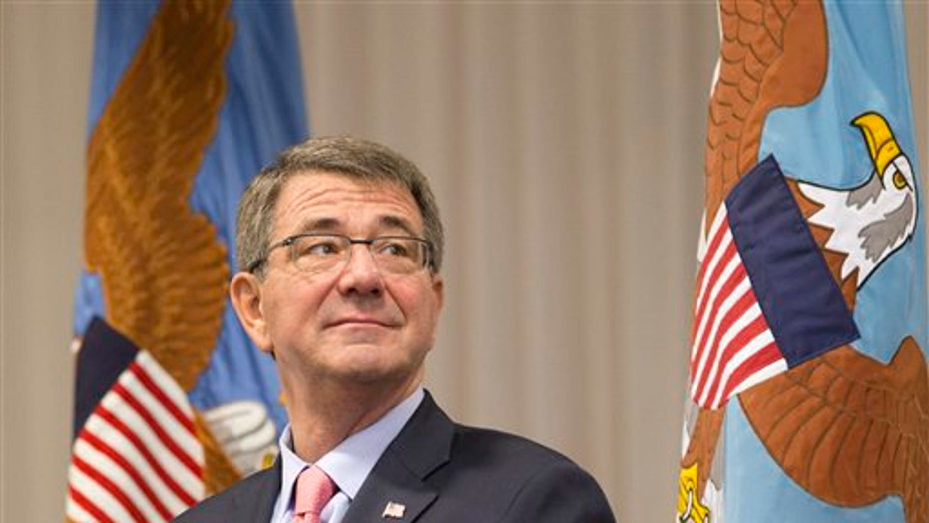 Defense Secretary Ash Carter watches during a change of command ceremony, Thursday, Jan. 14, 2016, at U.S. Southern Command in Miami. Ten prisoners from Yemen who were held at Guantanamo Bay, Cuba have been released and sent to the Middle Eastern nation of Oman for resettlement, Carter said Thursday. (AP Photo/Wilfredo Lee)