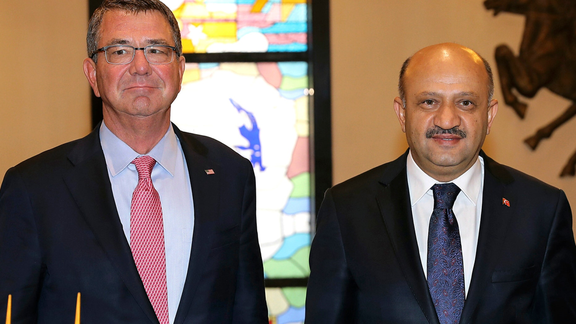 Oct. 21, 2016: U.S Secretary of Defense Ash Carter, left, and his Turkish counterpart Fikri Isik pose for a photo before a meeting at the Defense Ministry in Ankara