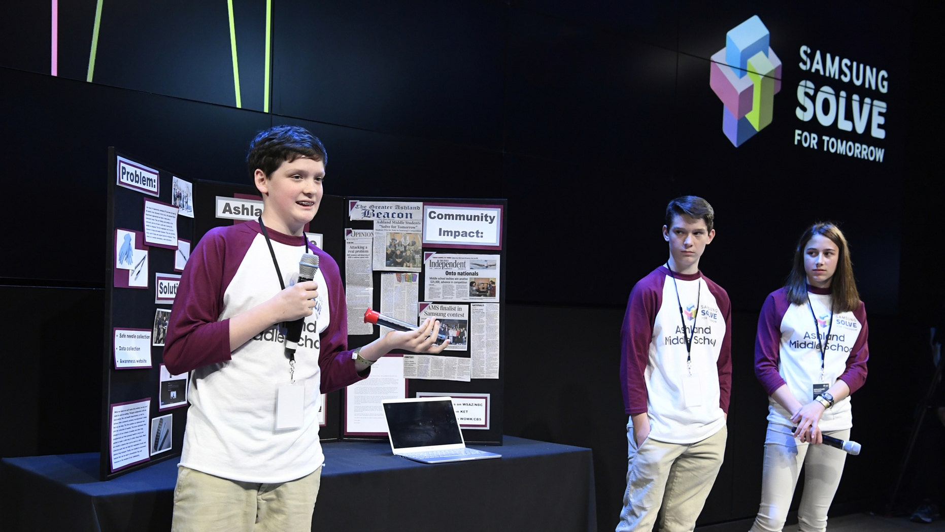 Students (left to right) Isaac Campbell, Caleb Campbell and Aubree Hay from Ashland Middle School in Ashland, KY present their STEAM project to a panel of judges at the Samsung Solve for Tomorrow national finalist pitch event on Monday, April 9, 2018 in New York City. The students created a device that allows first responders to safely collect hazardous hypodermic needles (Samsung)
