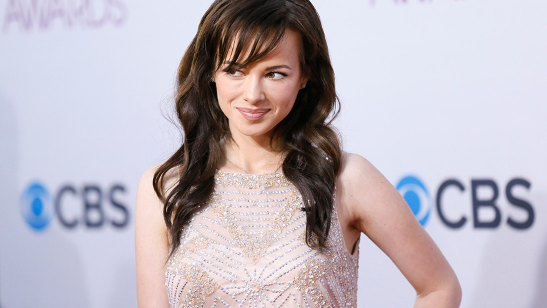 """Actress Ashley Rickards, of the television series """"Awkward,"""" arrives at the 2013 People's Choice Awards in Los Angeles, January 9, 2013."""