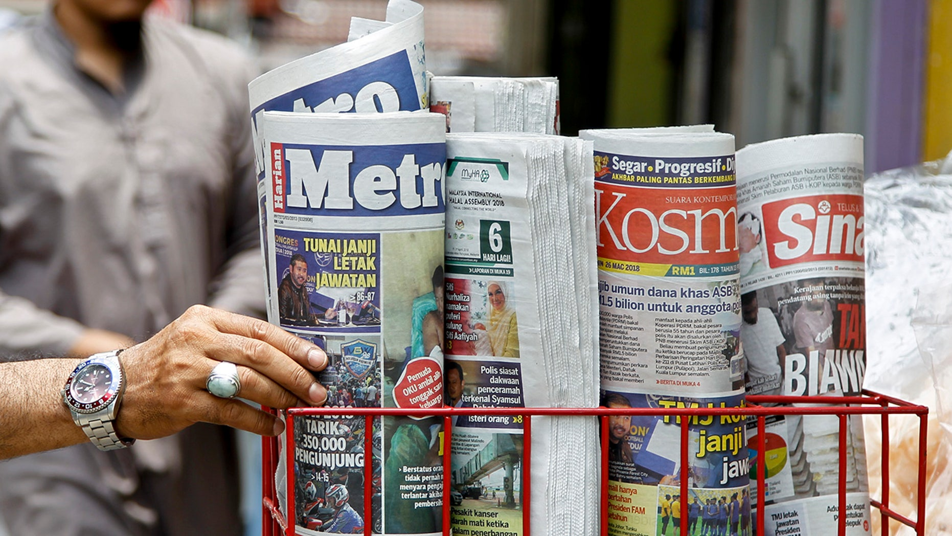 A Malaysian bill would give fake news peddlers a 10-year prison term.