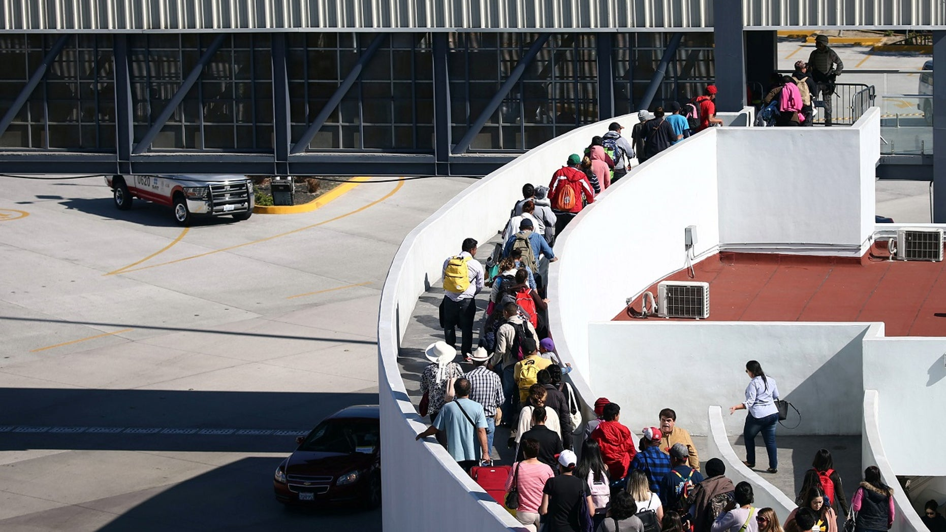 Roughly 70 migrants crossed the border into the United States Friday morning.