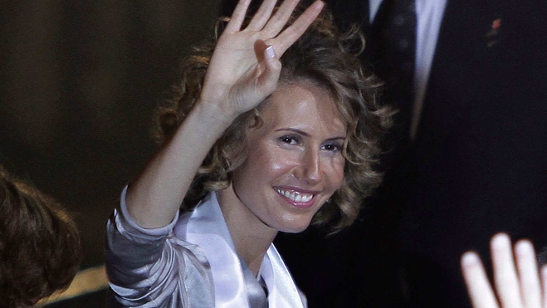 Sept. 25, 2010: Syria's First Lady Asma al-Assad waves as she attends the opening ceremony for the 7th Special Olympics Middle East/North Africa (SOMENA) Regional Games in Damascus.